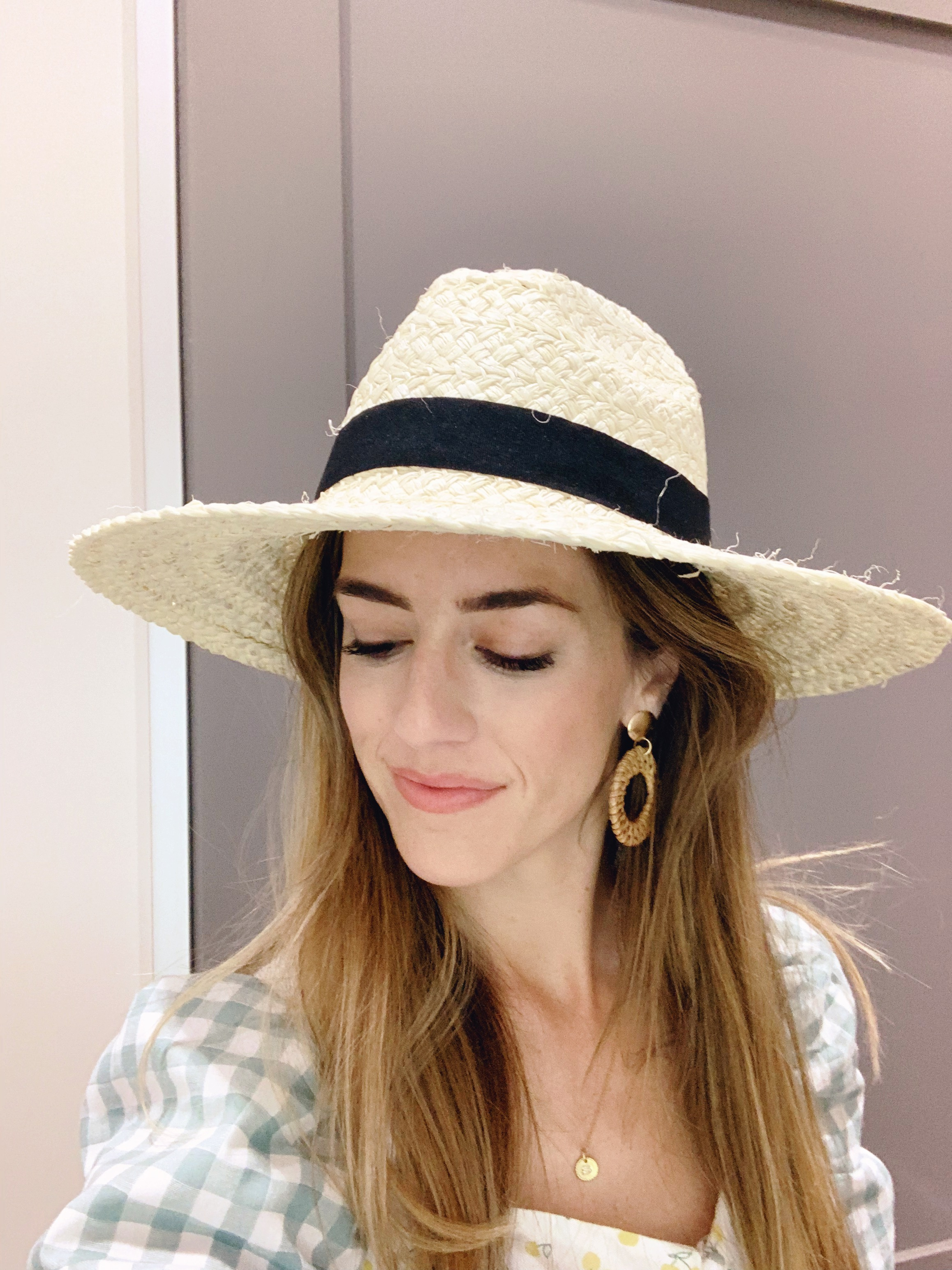 This is such a great knock off of the straw hat that I have been wearing constantly i purchased from Nordstrom. The straw is softer so its not as structured of a hat but it still holds its shape really nicely unlike a floppy straw hat. Currently on sale for $16.99.