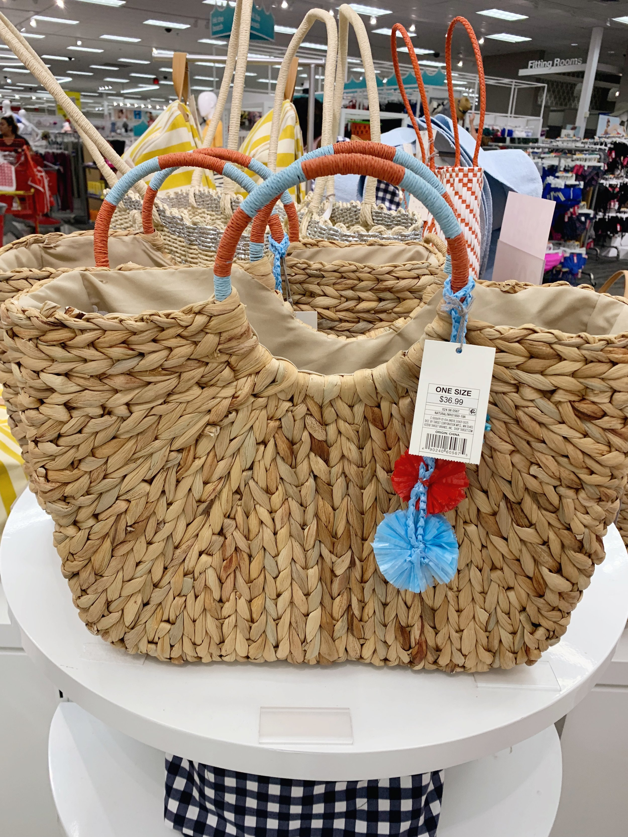 I'm sure you've seen variations of this bag everywhere this spring as it seems to be THE bag right now. I have one and love using it when I don't need to carry my big mom purse. The red and blue detail is a cute touch and its on sale for $25.00