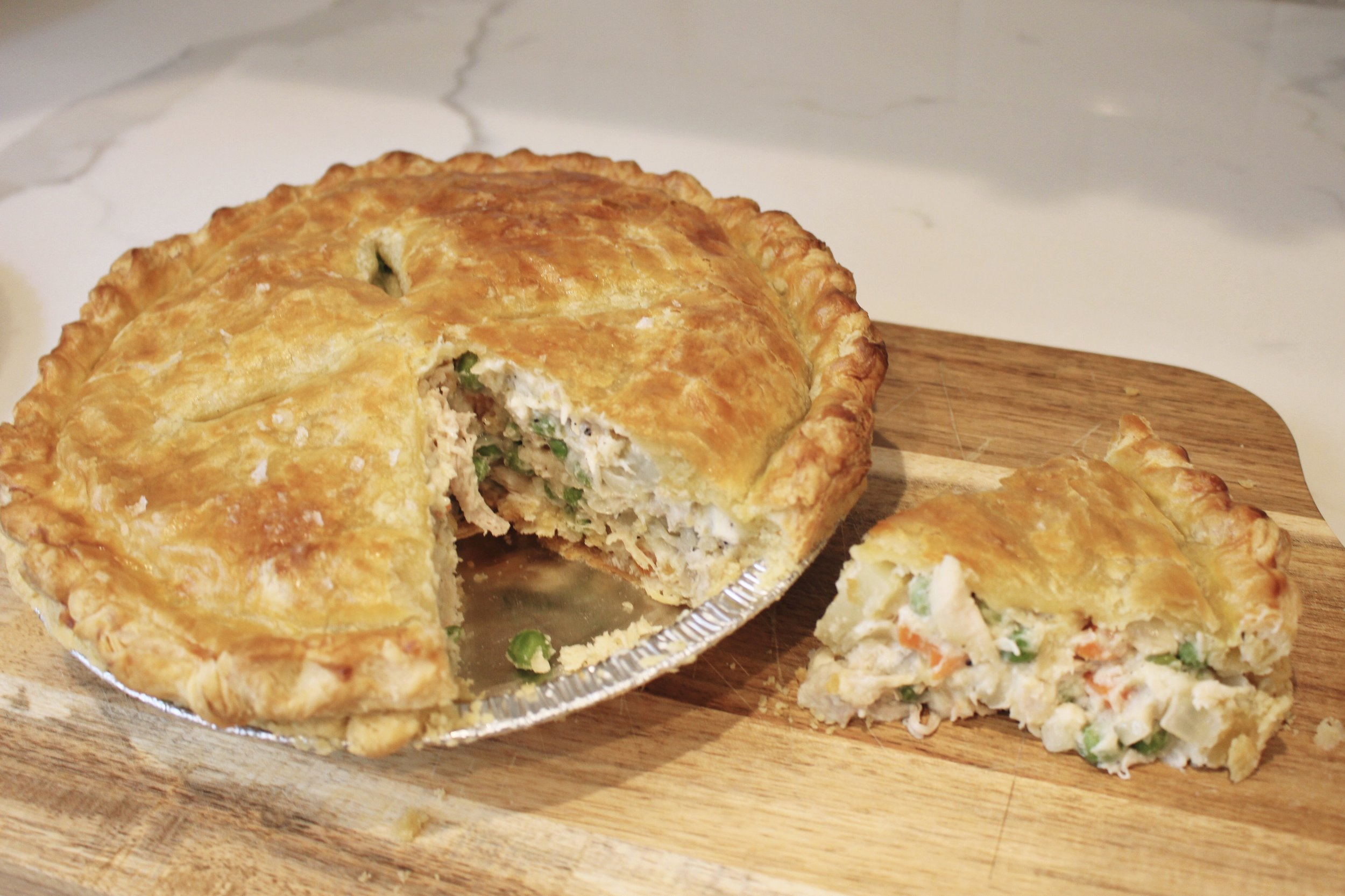 Chicken Pot Pie is honestly one of my first meals I can remember eating as a kid so it is the epitome of comfort food in my book. It was a staple in our home and once I started cooking regularly myself, i wanted to find the best version of this American cuisine classic. I have tweaked this recipe by omitting the poultry seasoning, adding 3 cloves of minced garlic and using puff pastry as my top layer instead of traditional pie crust. You are welcome to stick to the original recipe but I have found I like this version better. I like to serve this with a fruit salad, green salad or if I have time to prep it, a broccoli salad.