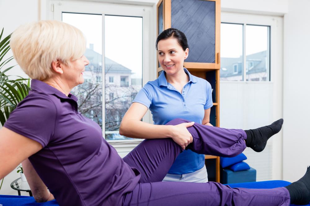 Therapist checking knee joint of senior woman.jpg