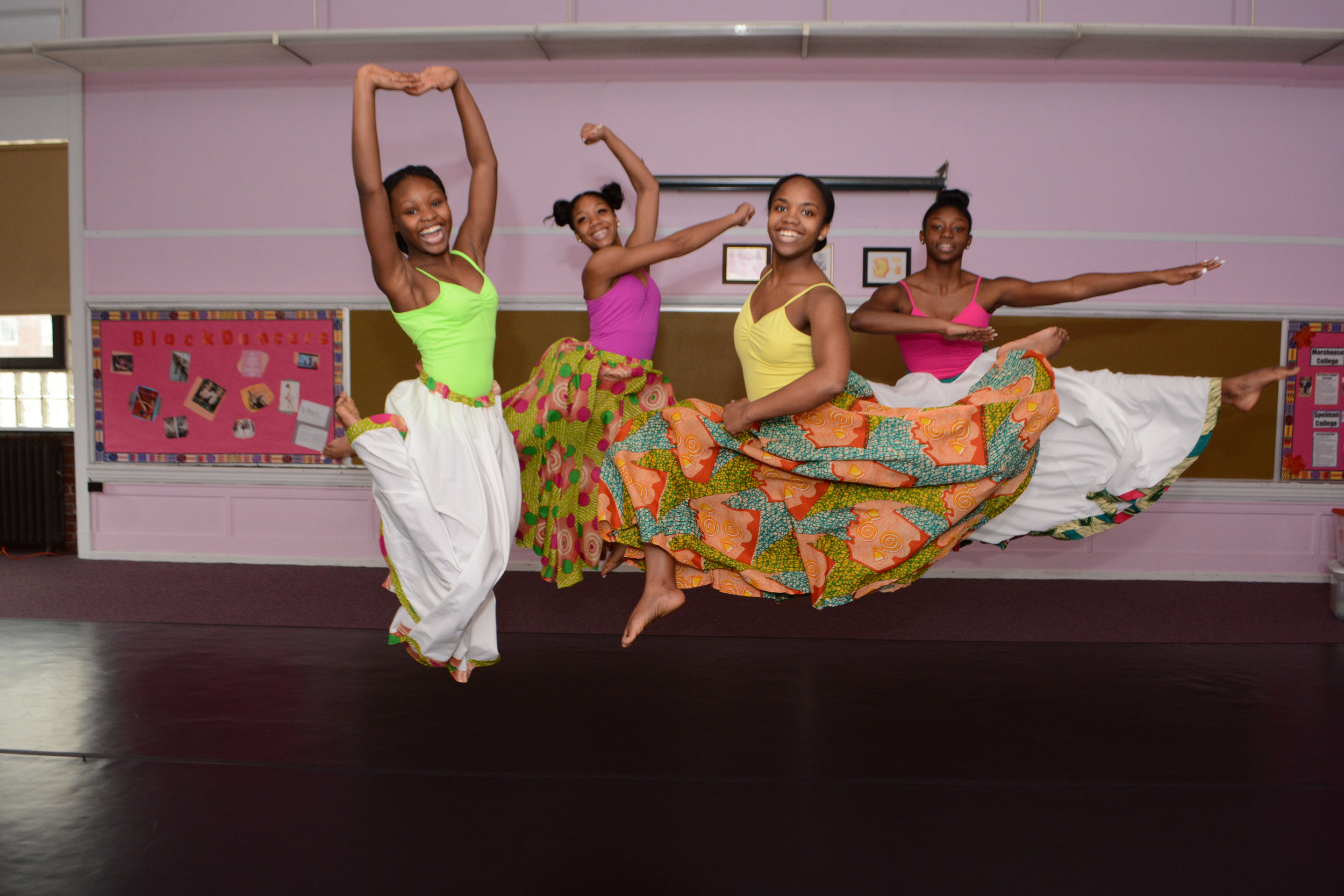 Jump for Joy! HDAT students celebrate after completing rehearsal for an upcoming concert