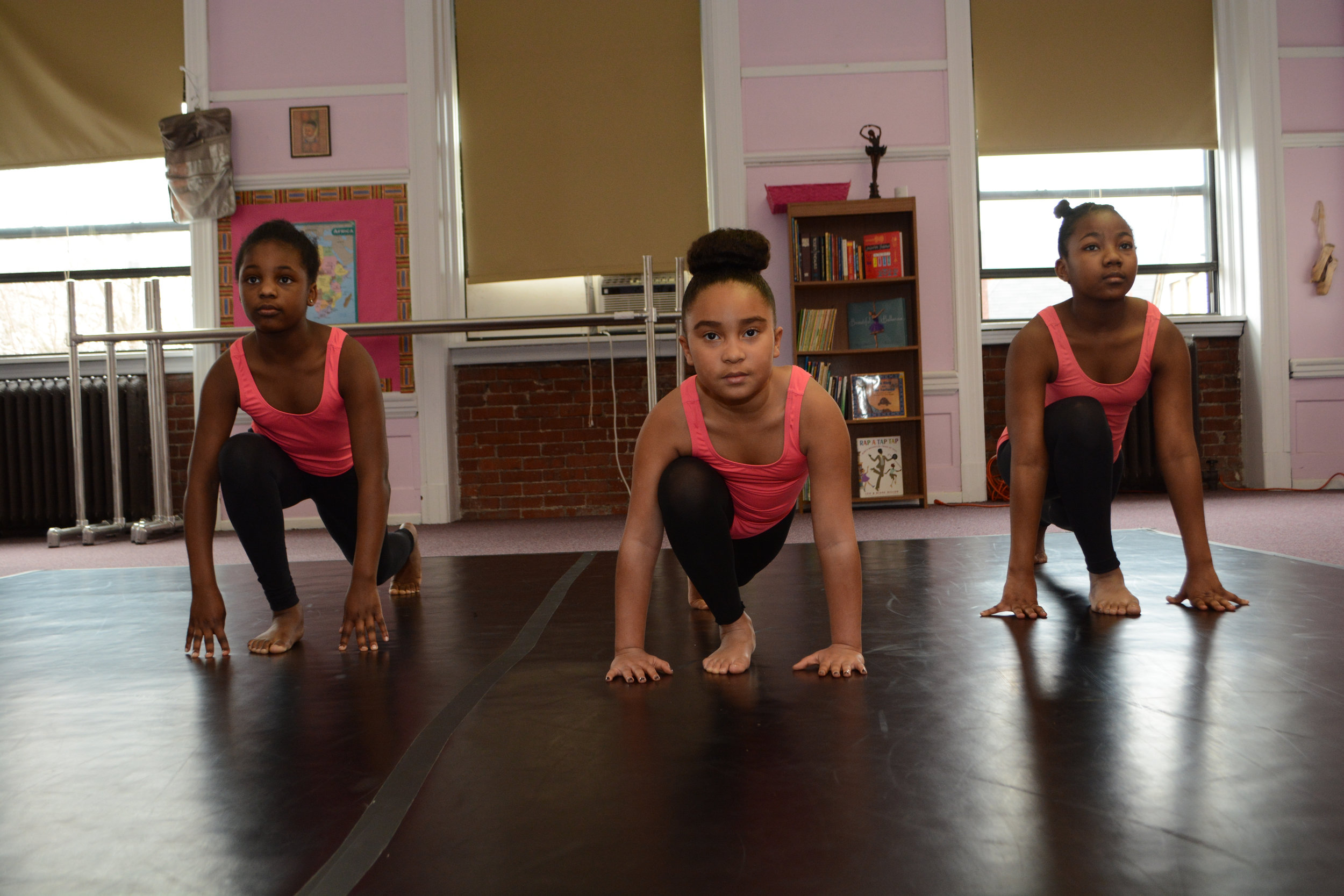 Hill Dance Academy Theatre students prepare for class through stretching