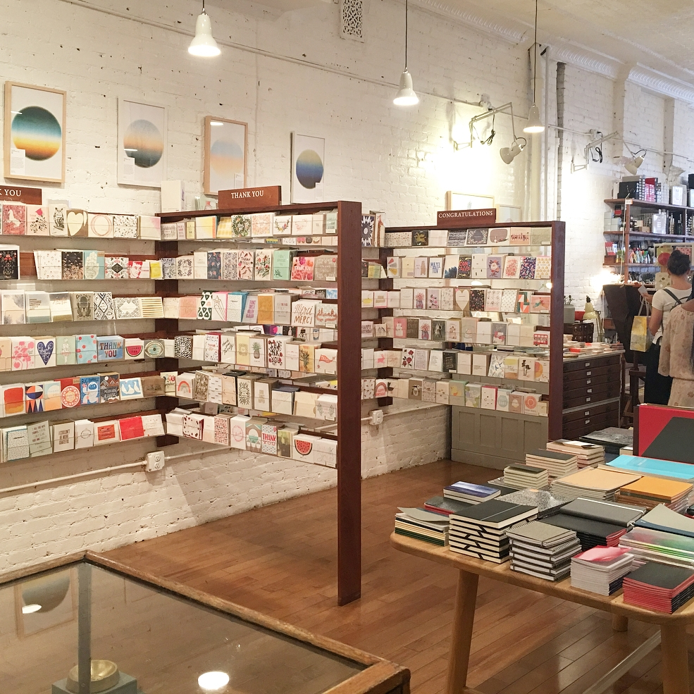Greeting cards at Goods for the Study in New York City are organized by occasion.