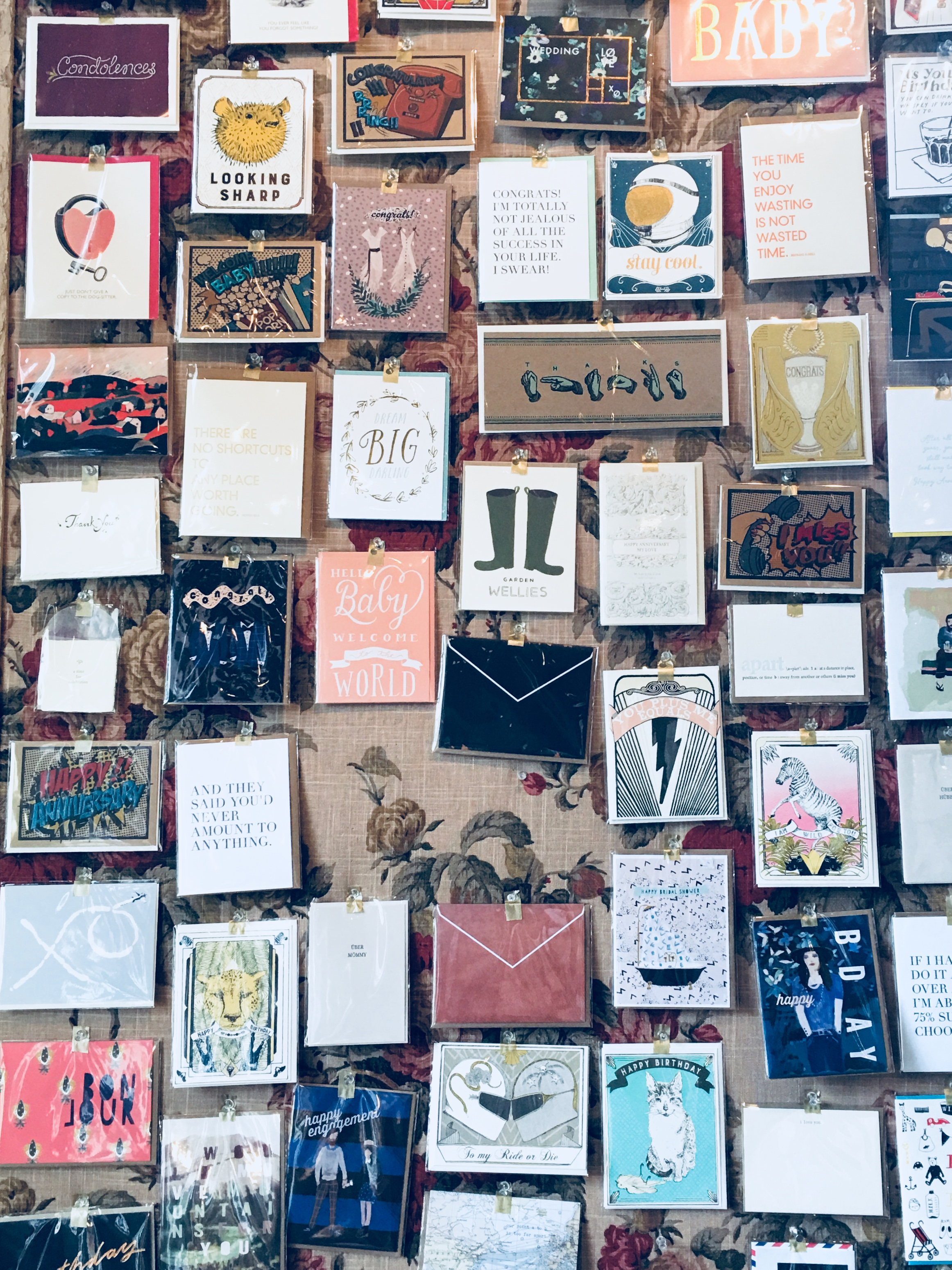 Individual cards are displayed artfully on the wall at Box Paper Scissor in New Orleans, LA.