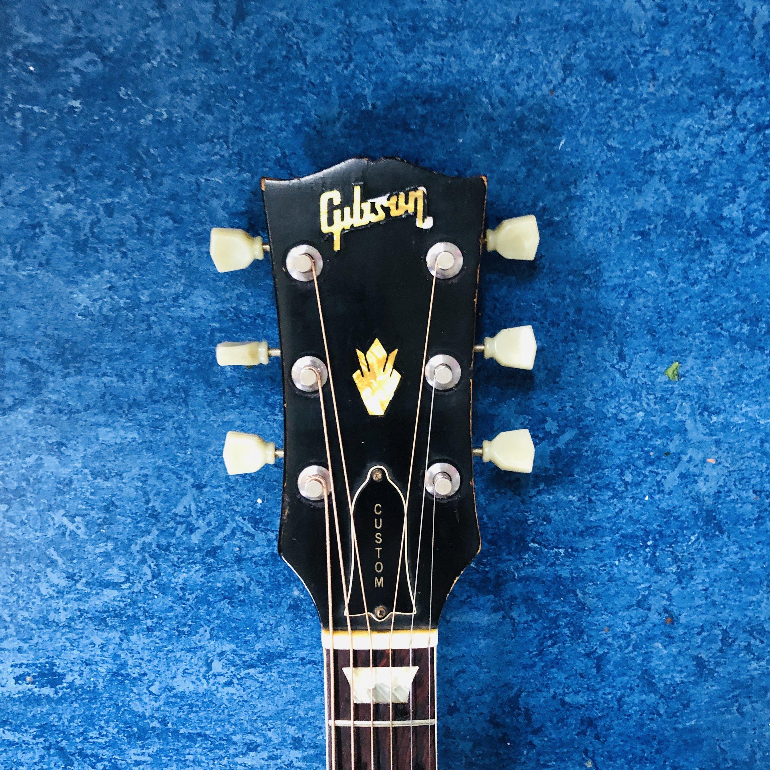 gibson-j160e-headstock.jpg