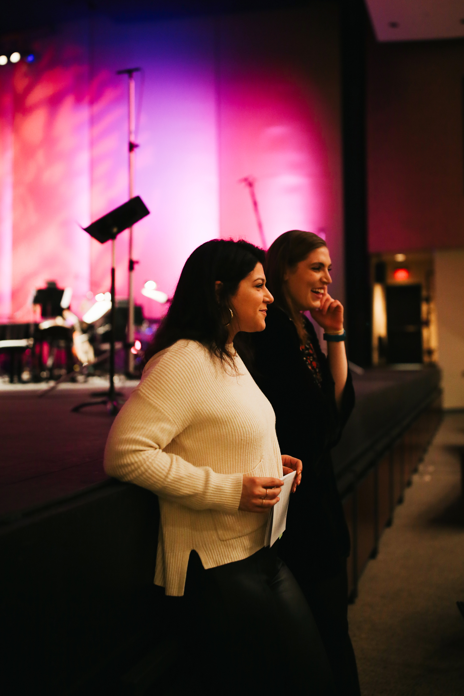 "PRACTICE MAKES PERFECT.  Rabbi Mark Schiftan's daughter, SarahRose Schiftan, rehearses with the lighting engineer for the her recitation of poem ""Take Me Under Your Wing"" as part of the HGM premiere."