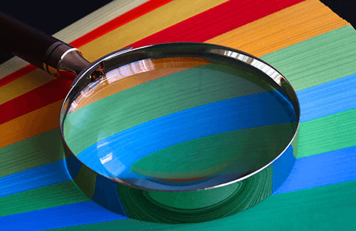 magnifying glass on colourful background