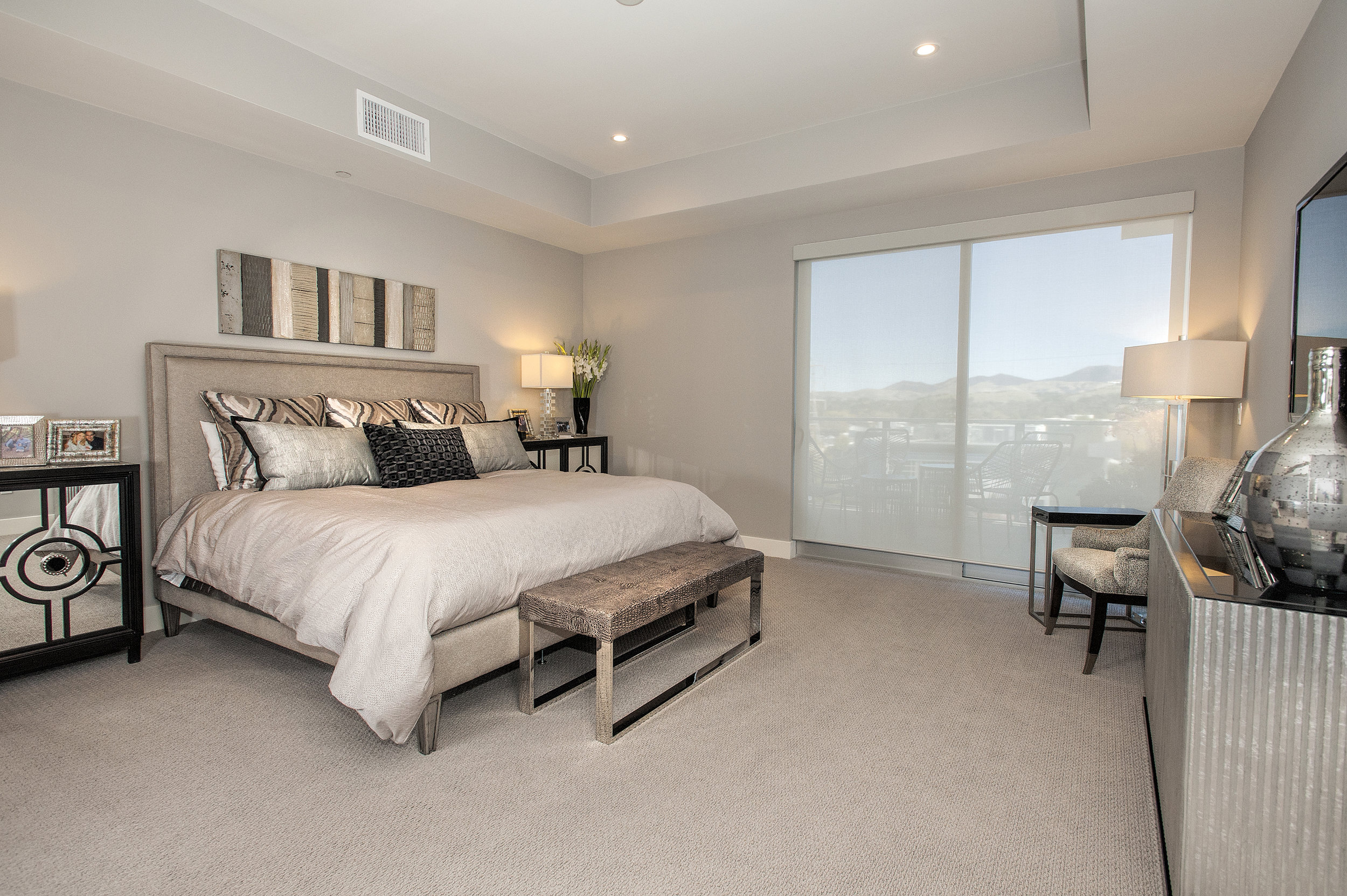 Bedroom with gray furnishing and a glass window