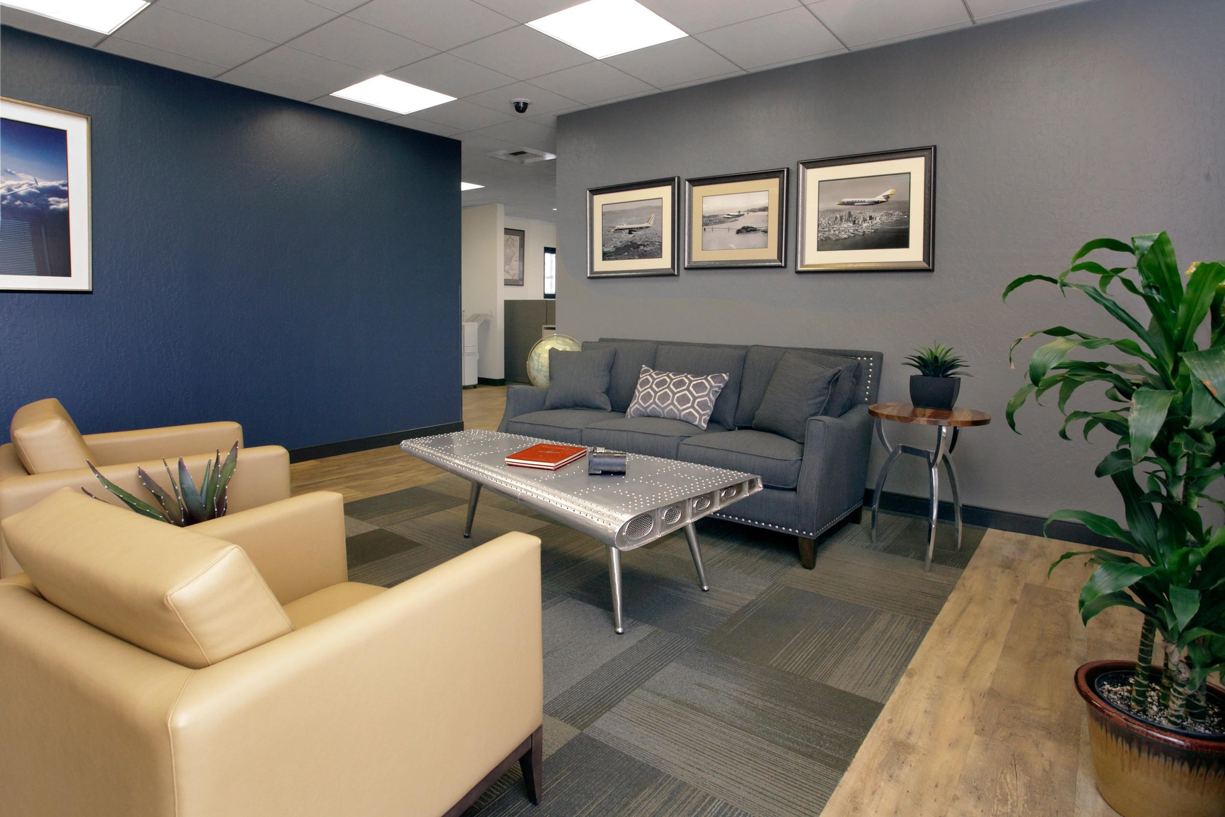 Guest lounge with navy blue and gray furnishing, sofa sets and vinyl tile flooring