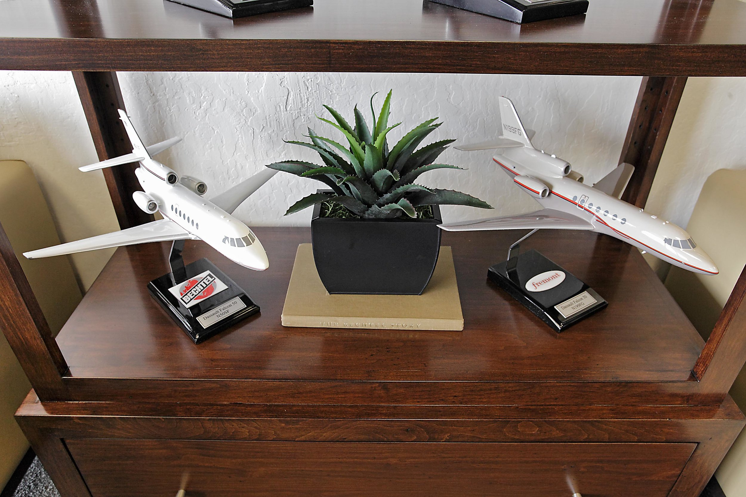 Airplane figurine and a flower vase