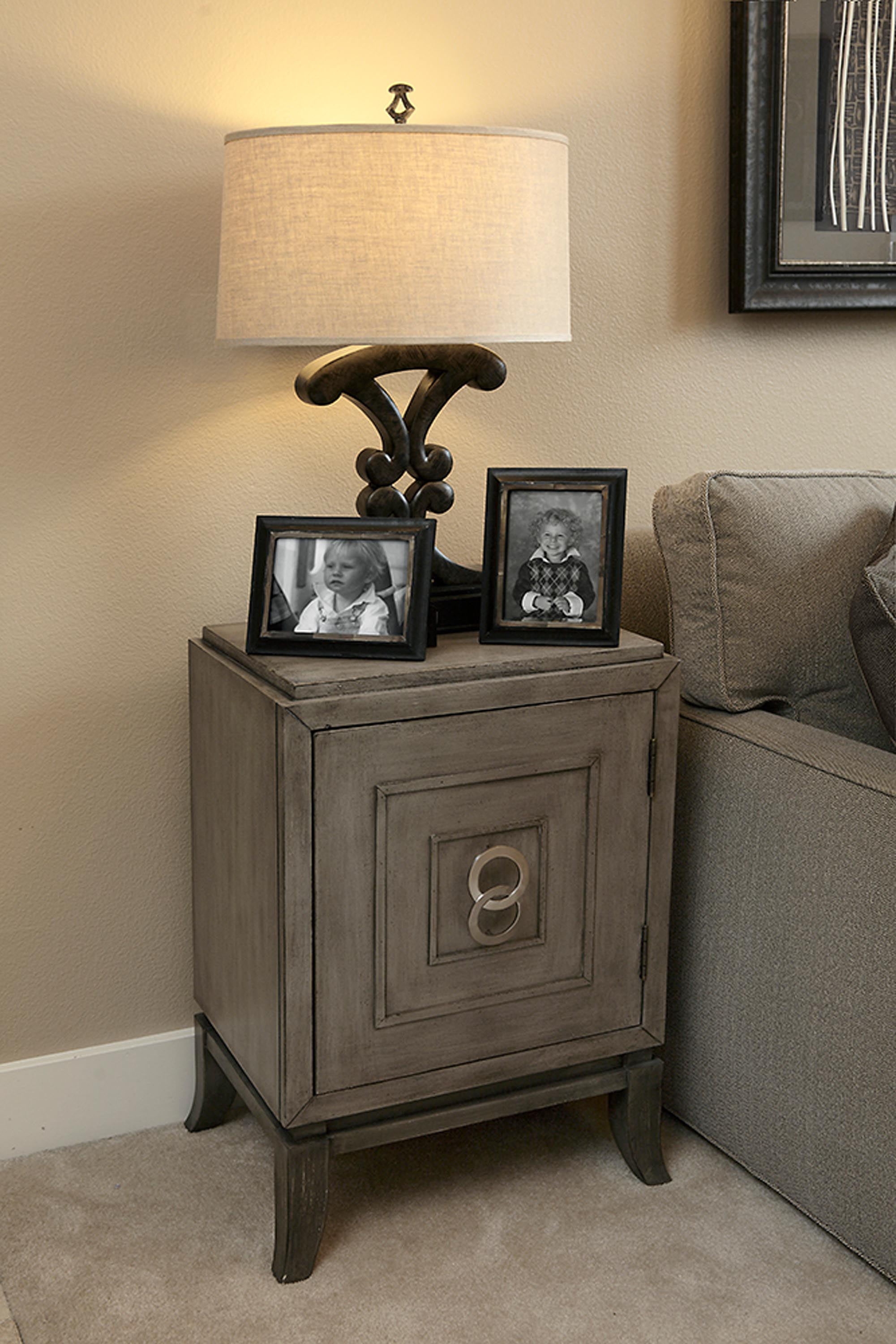 Elegant two picture frame and lamp above the cabinet