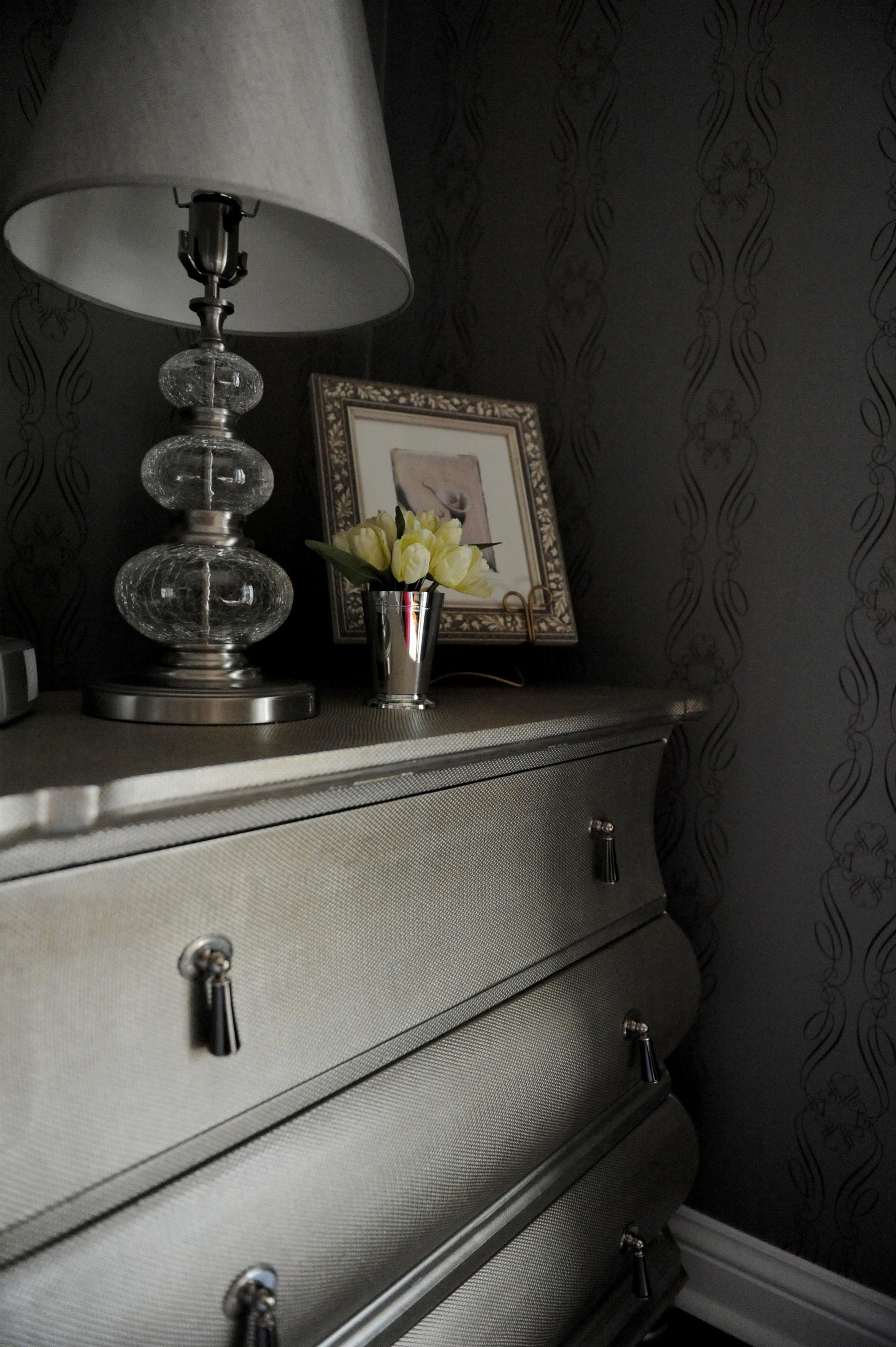 Elegant picture frame and lamp above cabinet