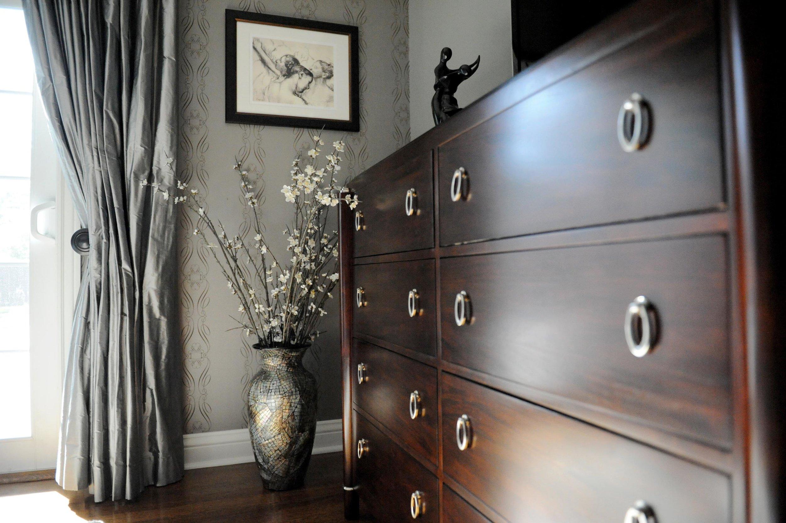 Stylish Cabinet and flower vase beside the window