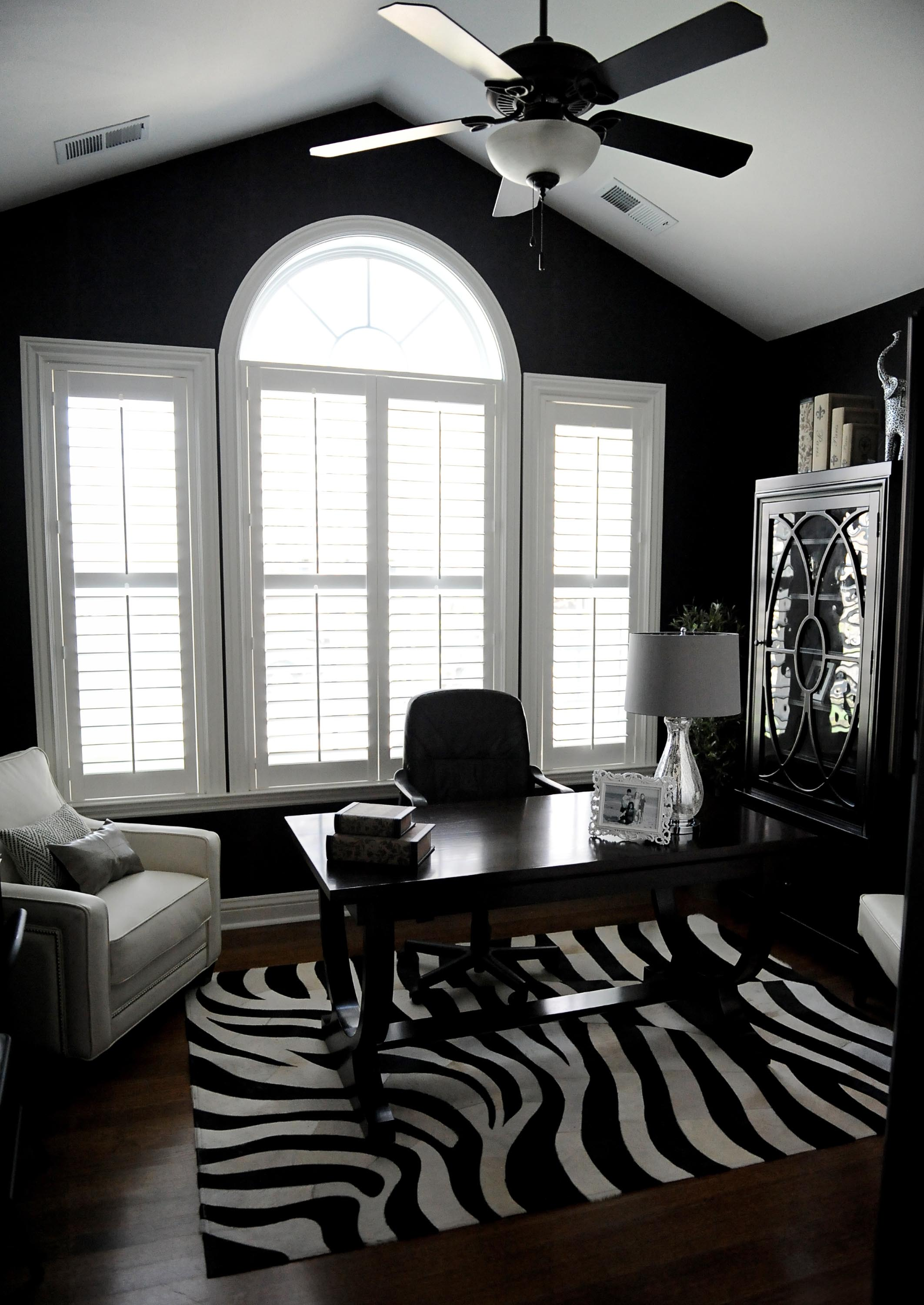 Home office with table and chair and a window
