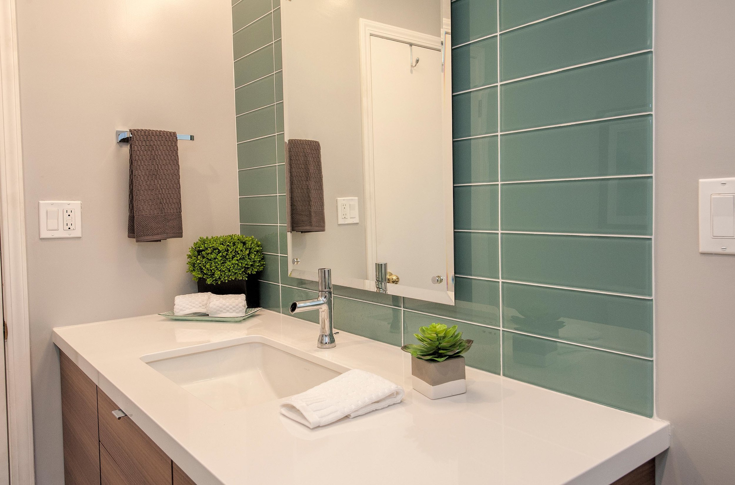 Stylish bathroom with custom cabinet and a faucet
