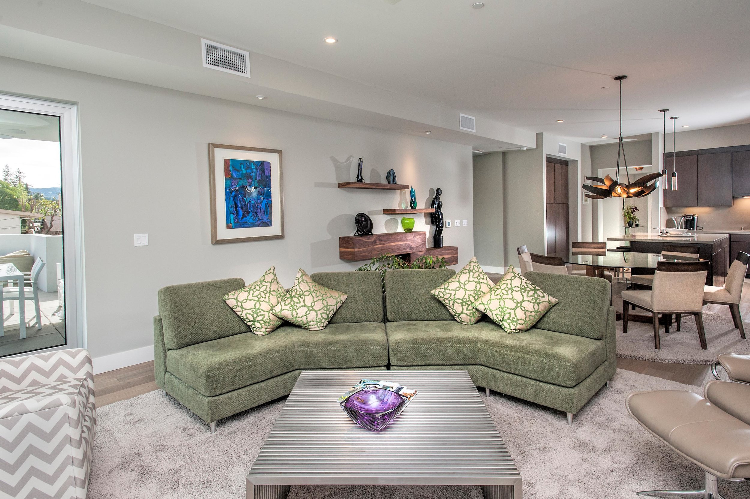 Living room with floor mattress and green sofa