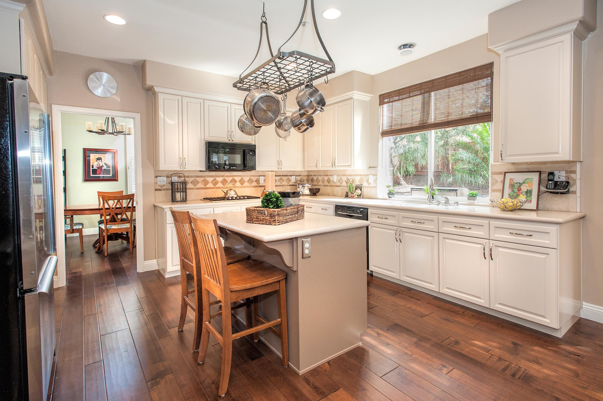 Vintage look kitchen with white cabinets and breakfast table