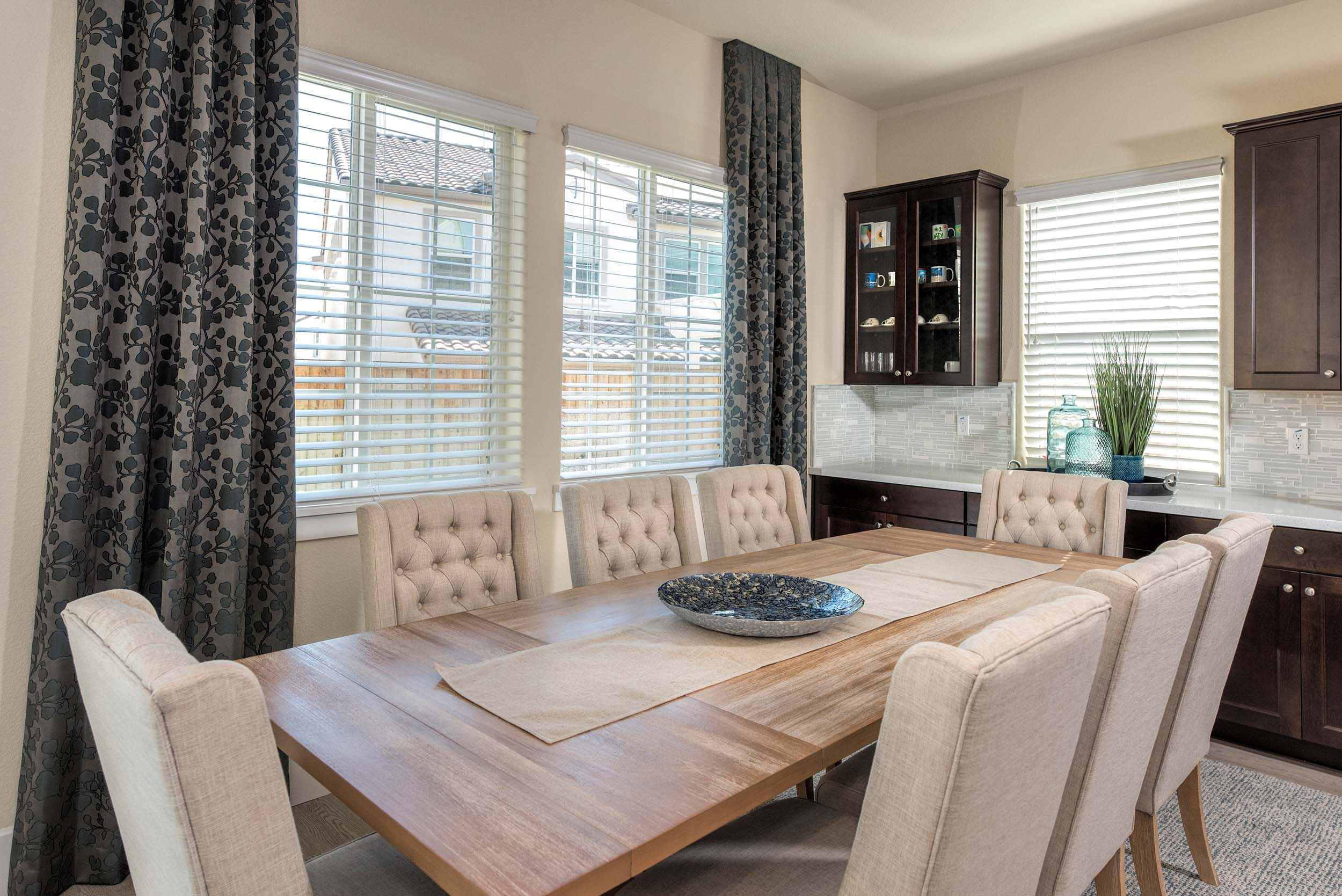 Dining table with chairs, large window, wooden table and wooden cabinet
