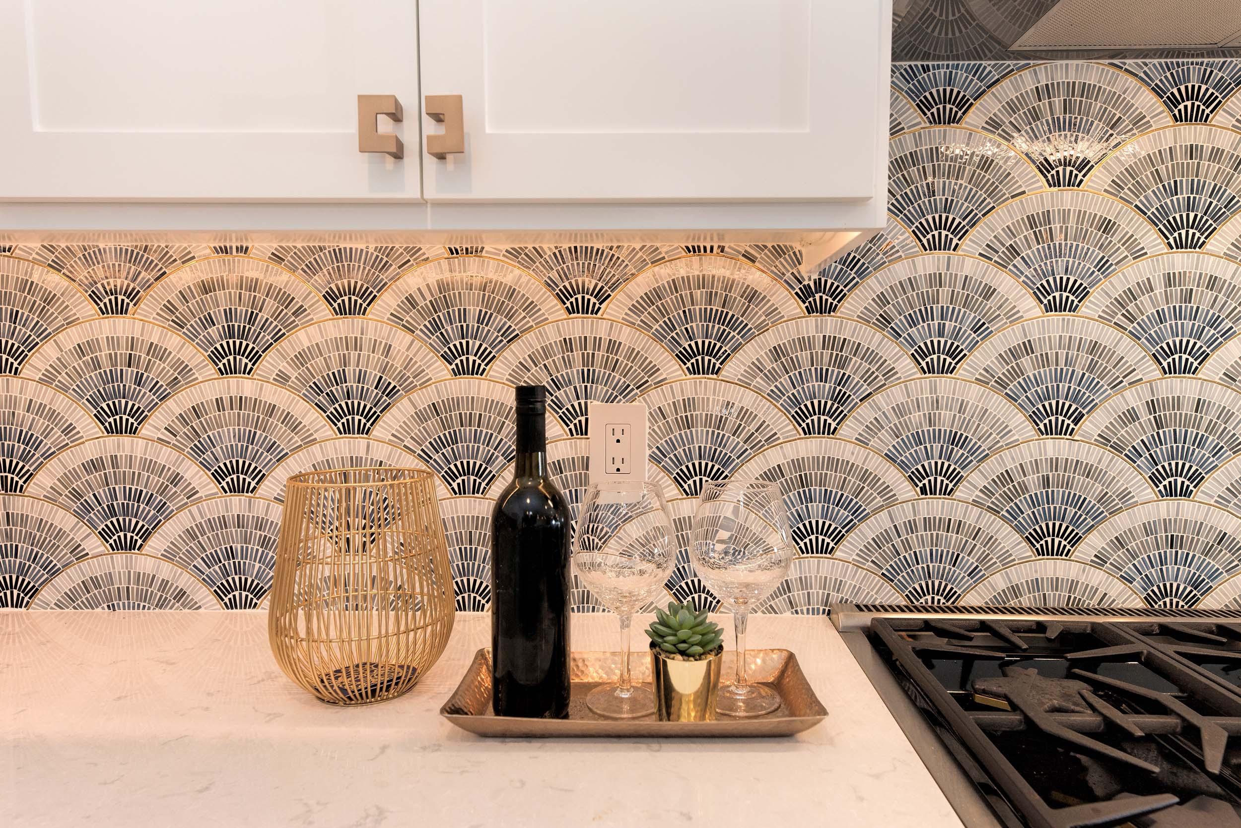 Kitchen interior with granite countertop, wine and wine glasses