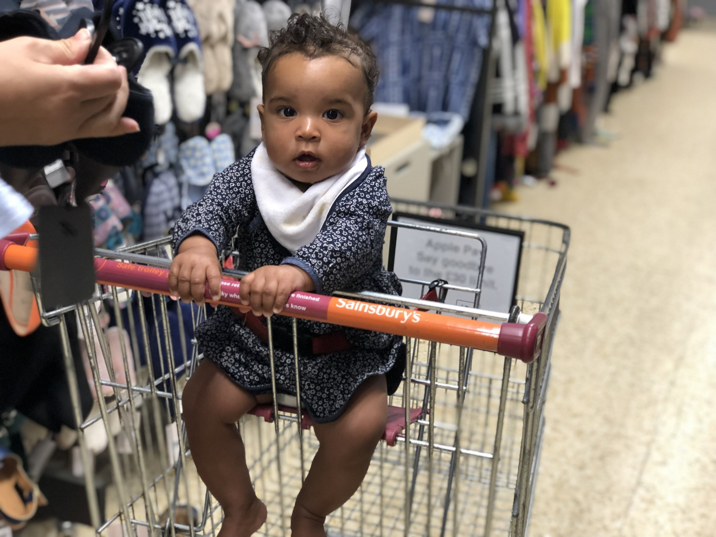 Growing up too fast - in the trolley like a big girl