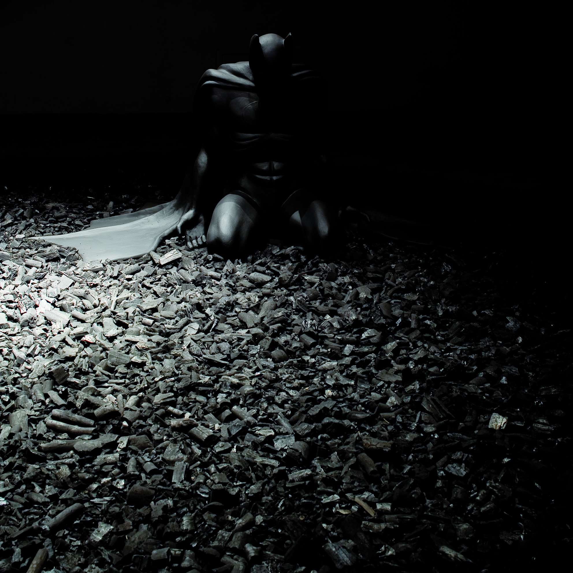 BACK IN BLACK , 2005 . Polystyrene, resin and charcoal, sculpture : 120x200x140 cm, charcoal : variable dimensions. Photo: Massimo Tomasini