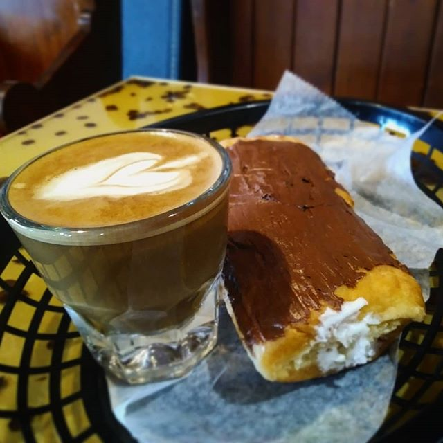 It's the perfect pairing! Handcrafted espresso drinks and fresh pastries from the one and only @copsanddoughnuts  #coffeeanddonuts #specialtycoffee #cortado #creamfilled #kissmecoffee #publicserviceannouncement