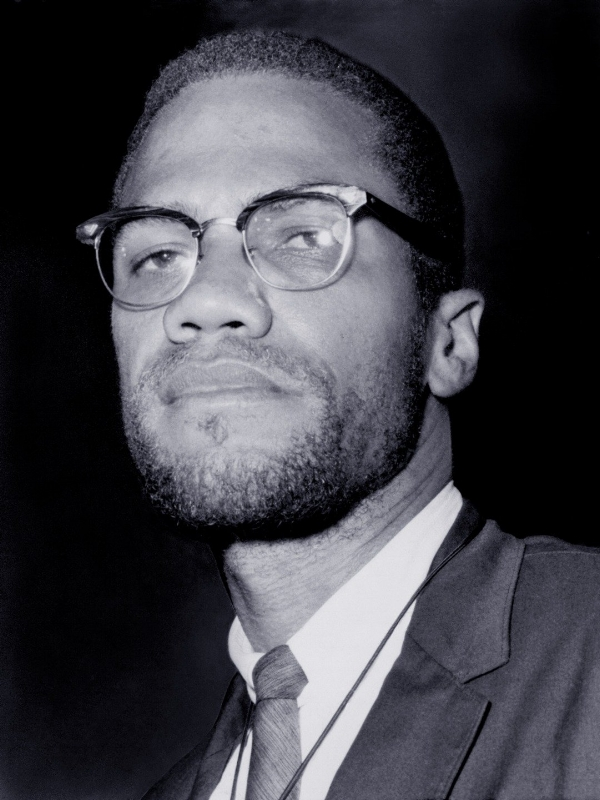 Malcolm X wearing Club Masters glasses.