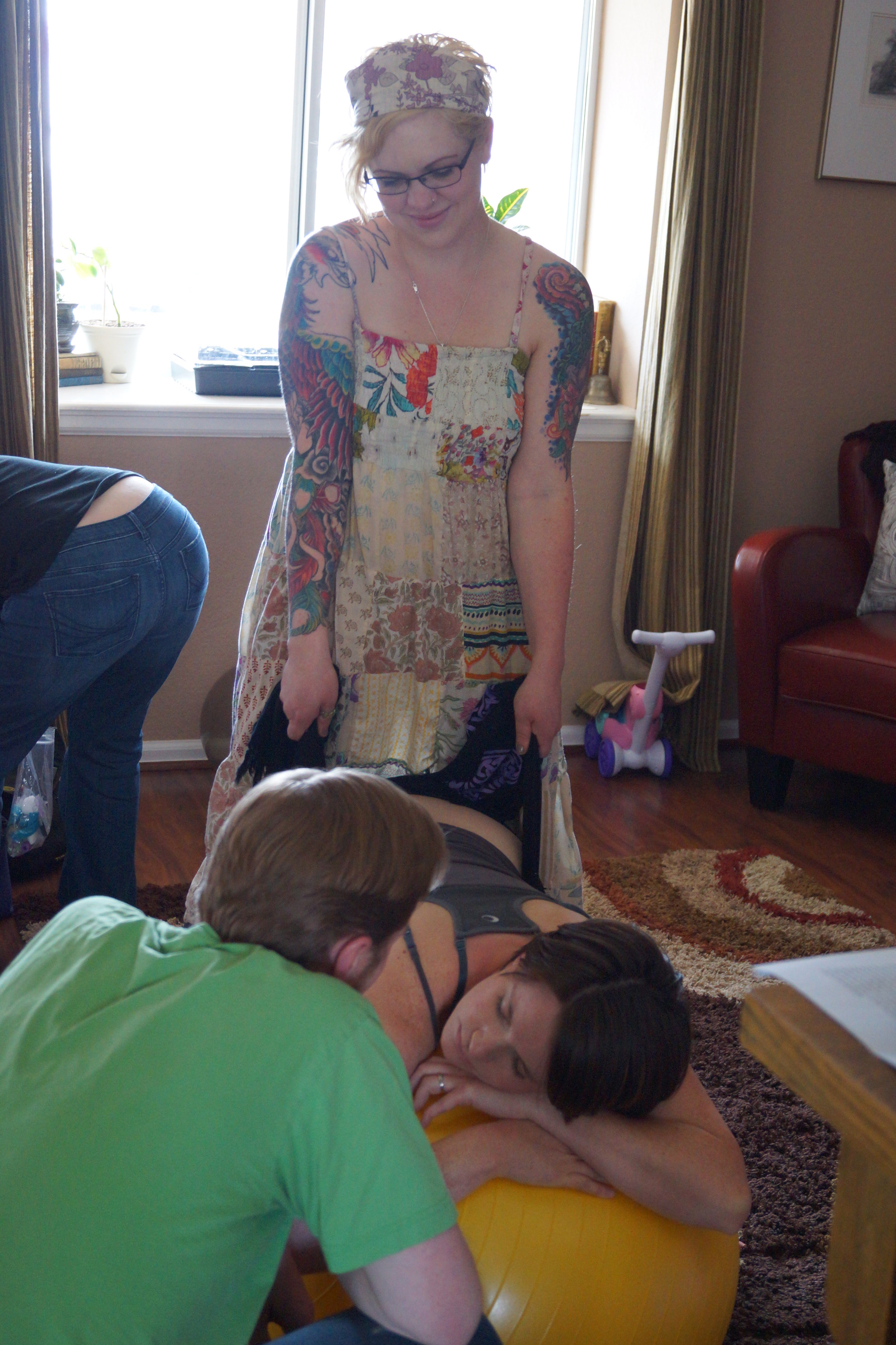 Amy using a rebozo at a birth