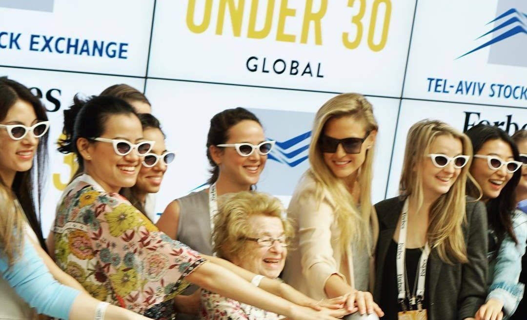 Women in the Forbes 2018 Under 30 Global Summit, including Dr. Ruth Westheimer, ringing the Tel Aviv Stock Exchange Bell.