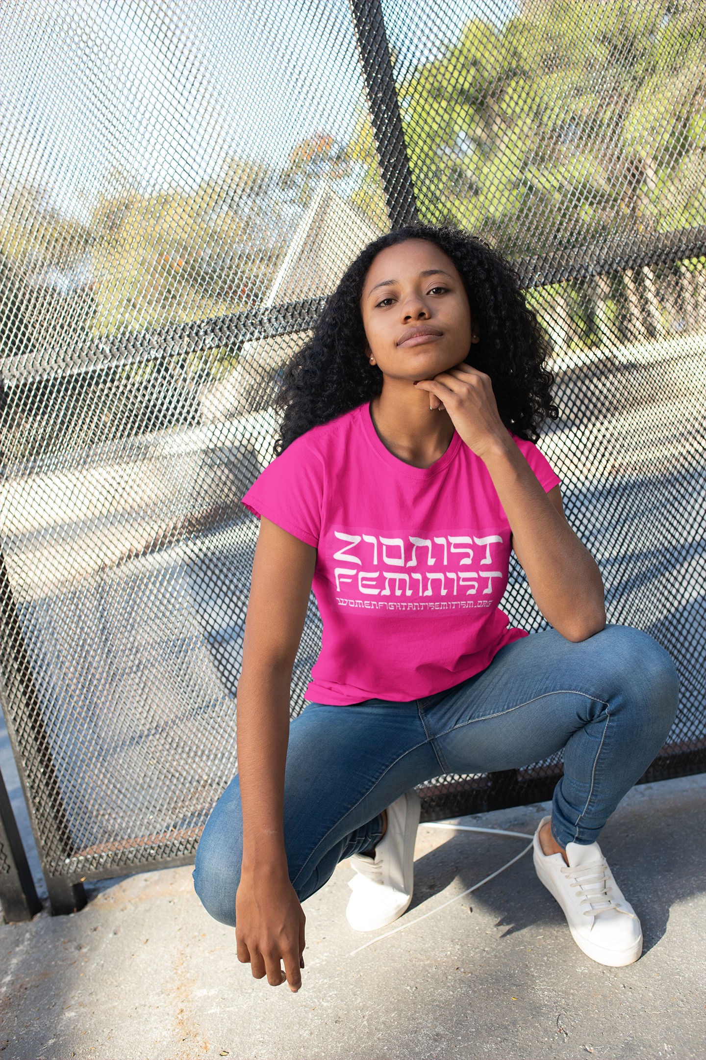 tshirt-mockup-of-a-girl-with-curly-hair-crouching-24095.png