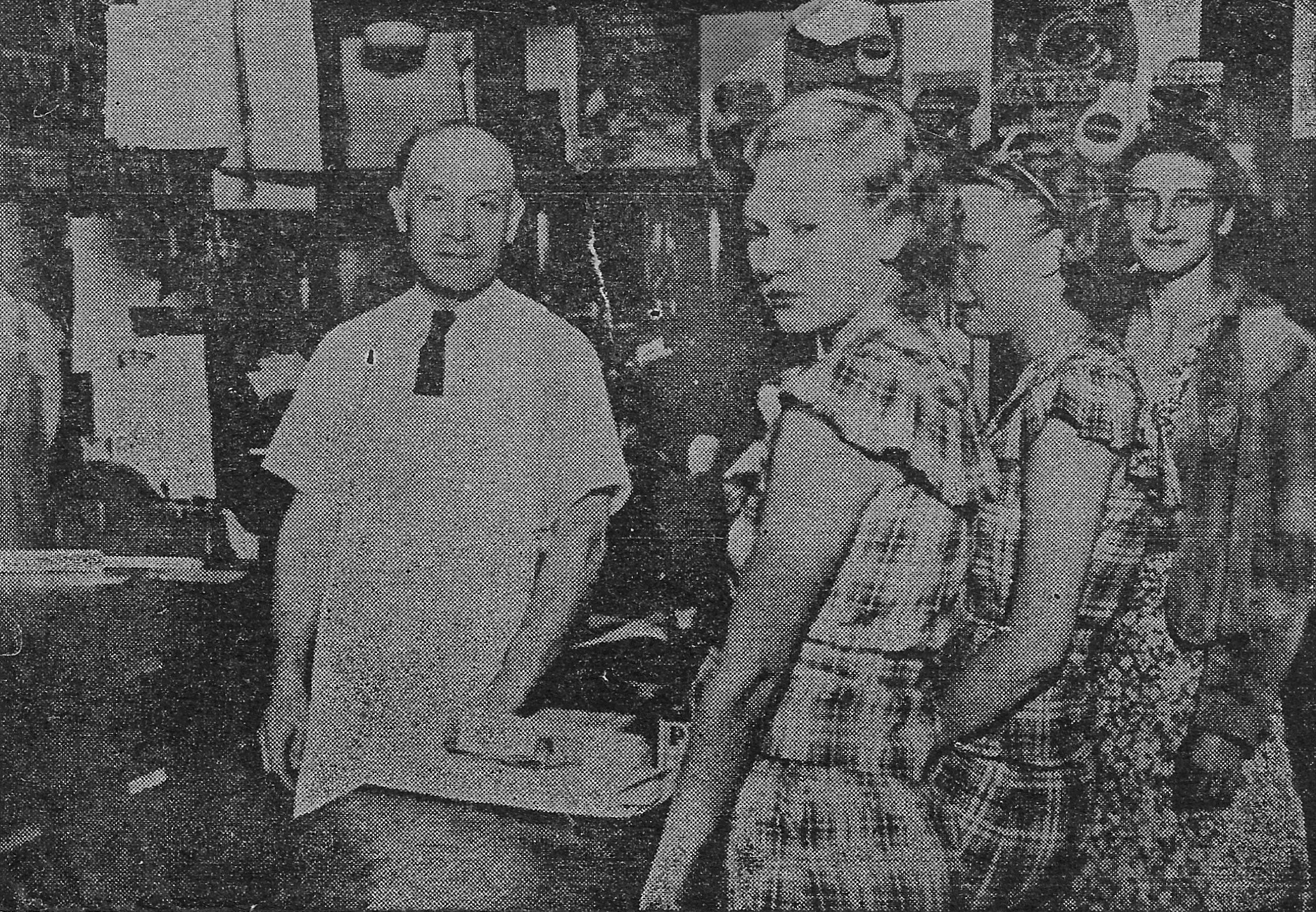 Grocery store owner Oscar Gallas is with customers Tillie and Irene Spanier, and Evelyn Hazel in this 1934 photograph.