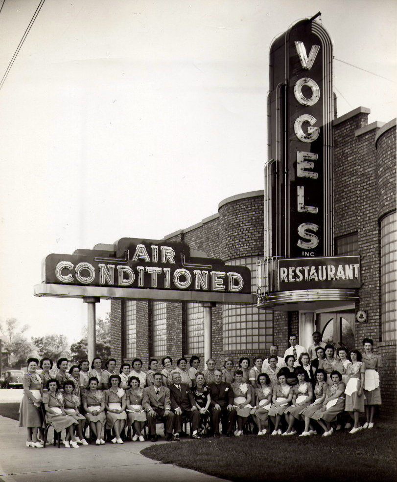 The wait staff pose outside of Vogel's restaurant.