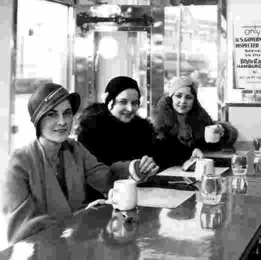 Three young women sit at the counter in the Whiting White Castle in the 1930s.
