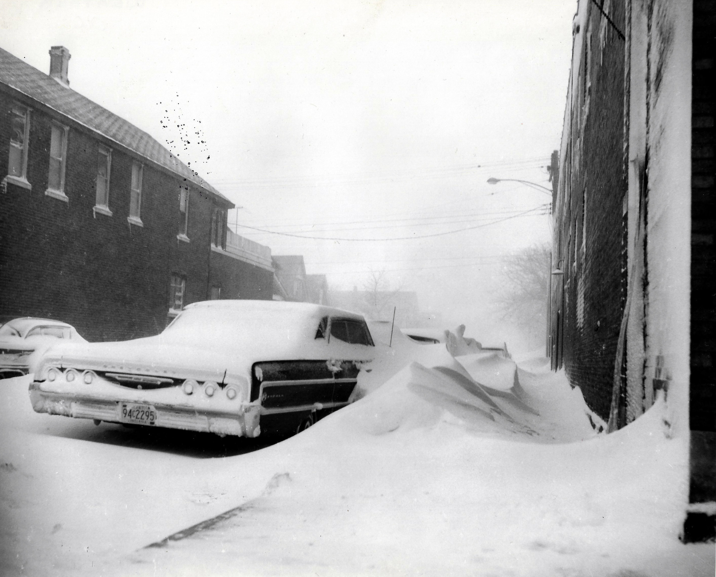 Drifts piled up alongside cars on all Whiting-Robertsdale streets, burying them for several days.