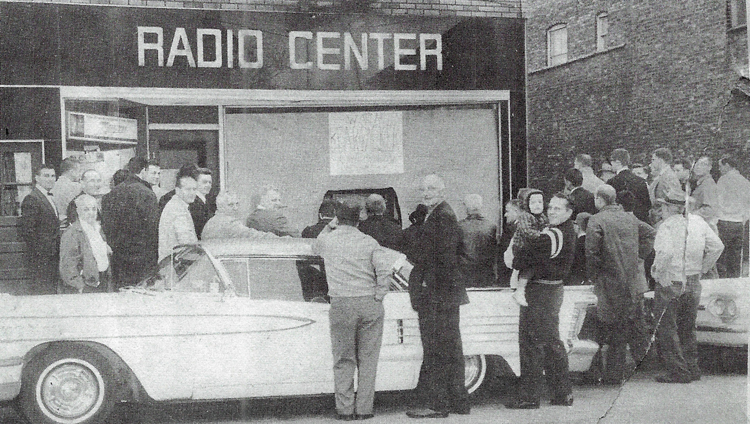 In November 1963, the game between the Chicago Bears and Green Bay Packers was blacked out in the Chicago area. So, John Kiraly, of the Radio Center (1542 119th Street) pulled in a signal from a South Bend television station and displayed it on a TV screen in the front window of his shop, drawing a crowd of football fans to watch. (Times-Grafic photograph)