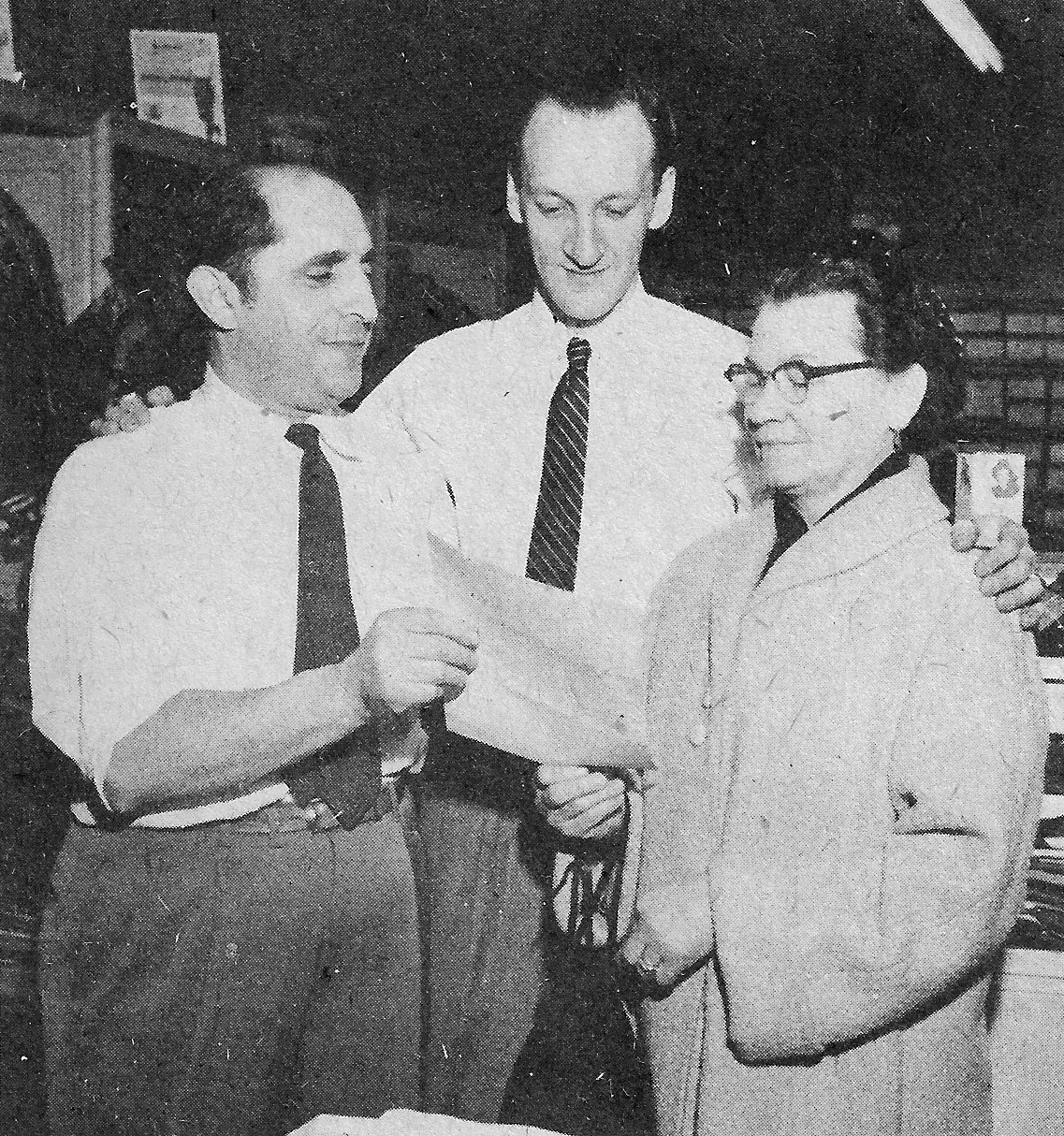 Mr. Burton, the owner of Burton's Men's Shop presents a gift certificate to Anna Mika of Euclid Avenue in a 1956 Whiting Merchants Good Will Promotion. (Times-Grafic Photo)
