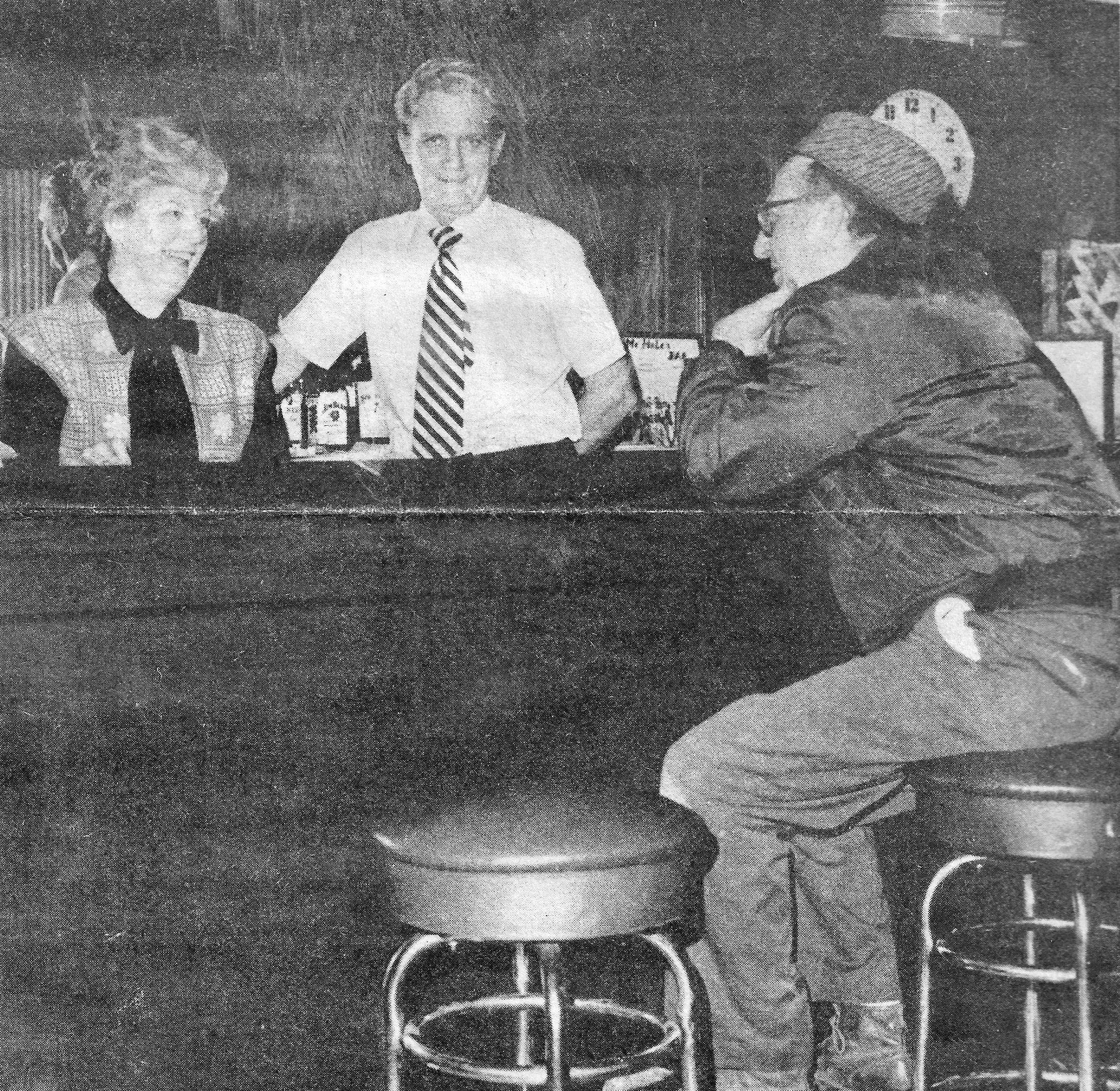 Ginny and Jim McHale chat with regular customer Larry Williams shortly before retiring from their bar. McHale's Tavern was a three-generation family business, originally at Fischrupp and New York Avenues. That was when it was established in the 1880s. It later moved to 1312 119th Street and remained in operation (except for the Prohibition years) until it was sold in 1978 and became the Center Lounge. (The Calumet Day photograph)