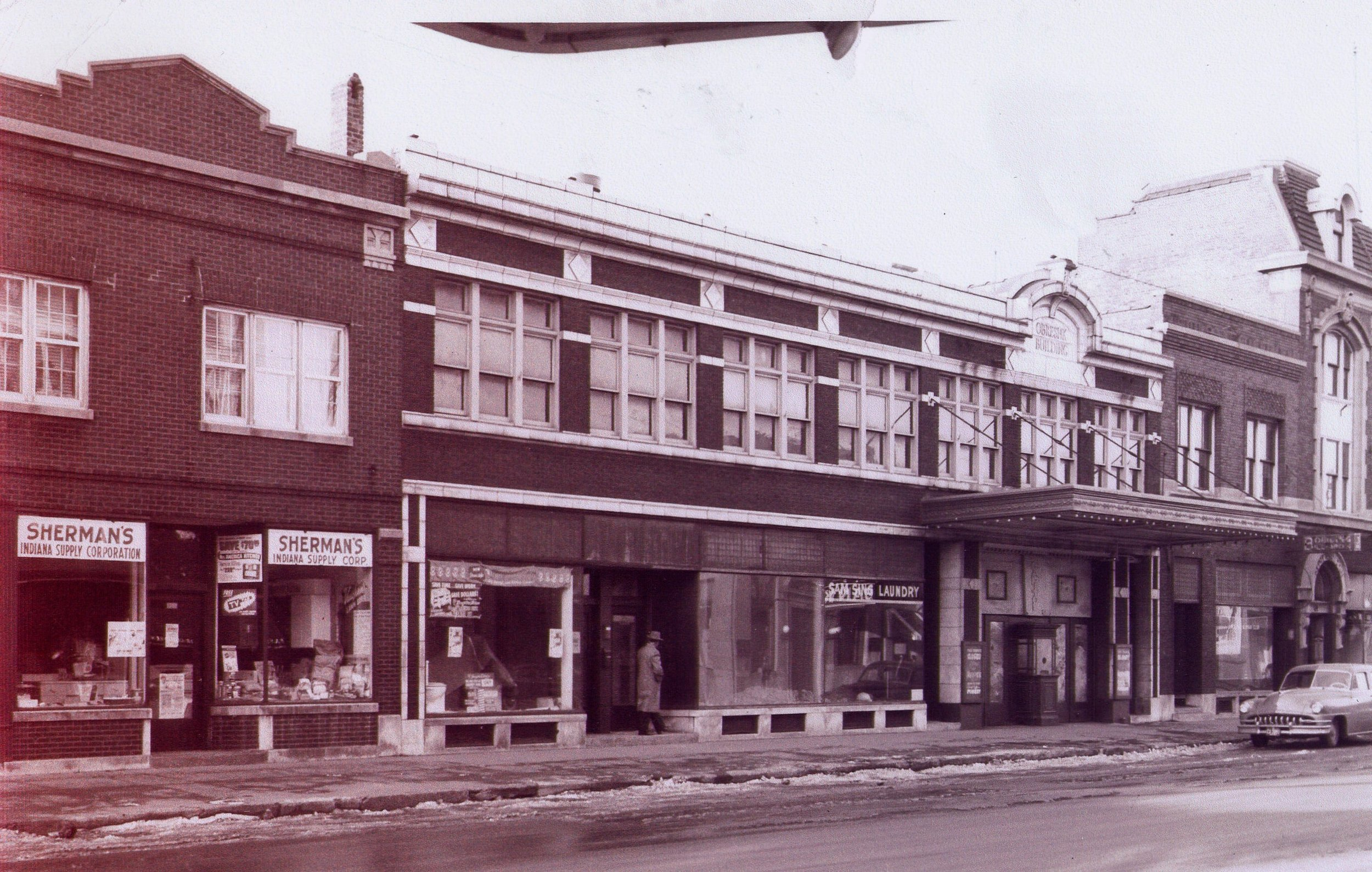 Beggar's Pizza is the current occupant of 1326 119th Street. But this is how that area looked in the early 1950s, after the Capitol Theatre closed down. The overhang on the front of the building (to the right in this photo) was the theatre entrance. Next door, toward the center of the photo, was Sam Sing Laundry, still visible in this picture. Sherman's Indiana Supply Store is on the left. It soon took over the space which had been occupied by the theatre and laundry.