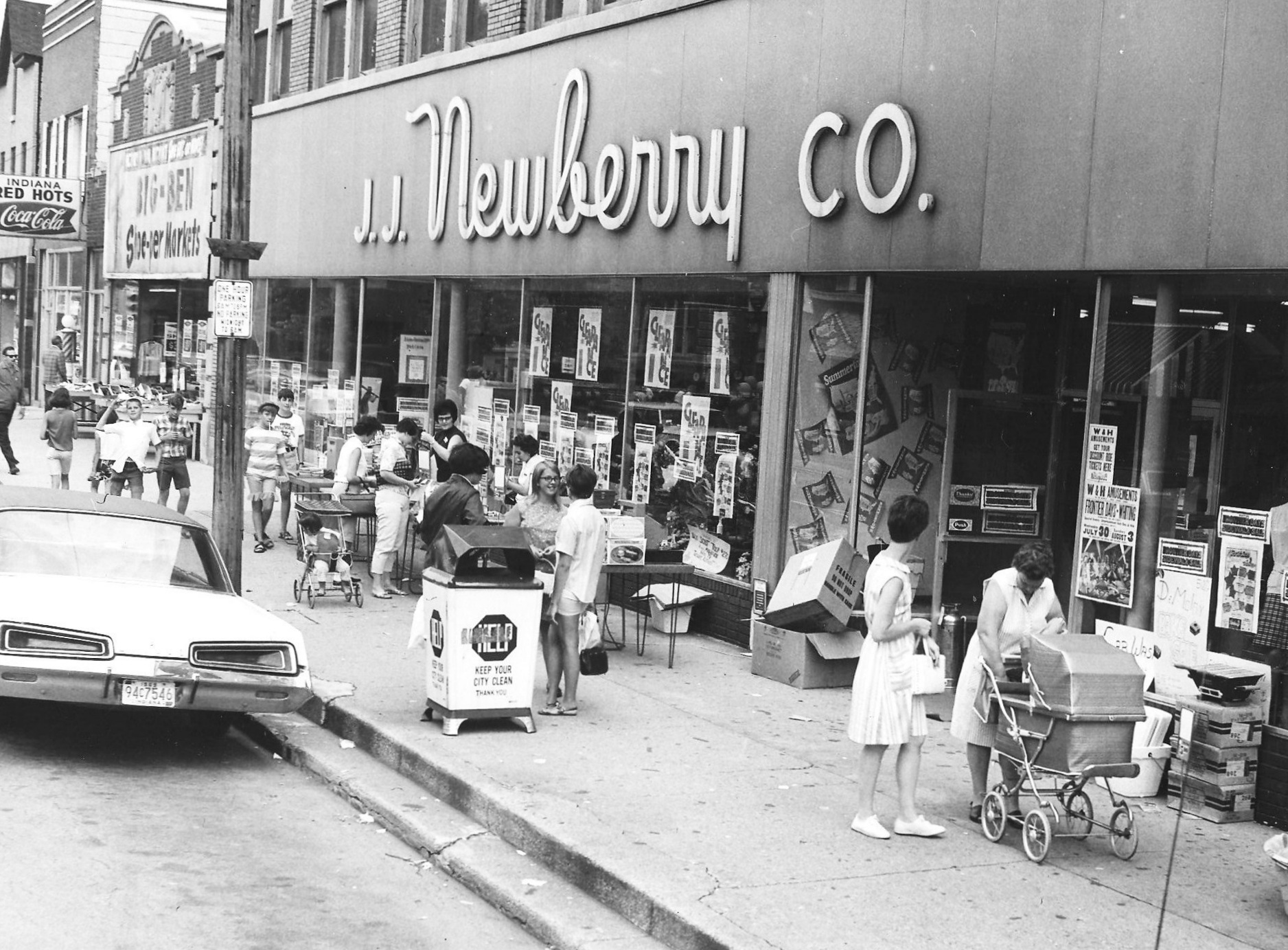 The J.J. Newberry Store, 1410 119th Street, in 1969. Next door is the Big Ben Shoe-Per Market at 1418 119th Street. And next to it is Indiana Red Hots at 1418 1/2. The hot dog stand was one of America's smallest restaurants. It was 45 feet long, but only seven feet wide, which was just enough room for the grill, the counter, the stools along the counter, and a small aisle to get from front to back. (Lovasko Studio photograph)