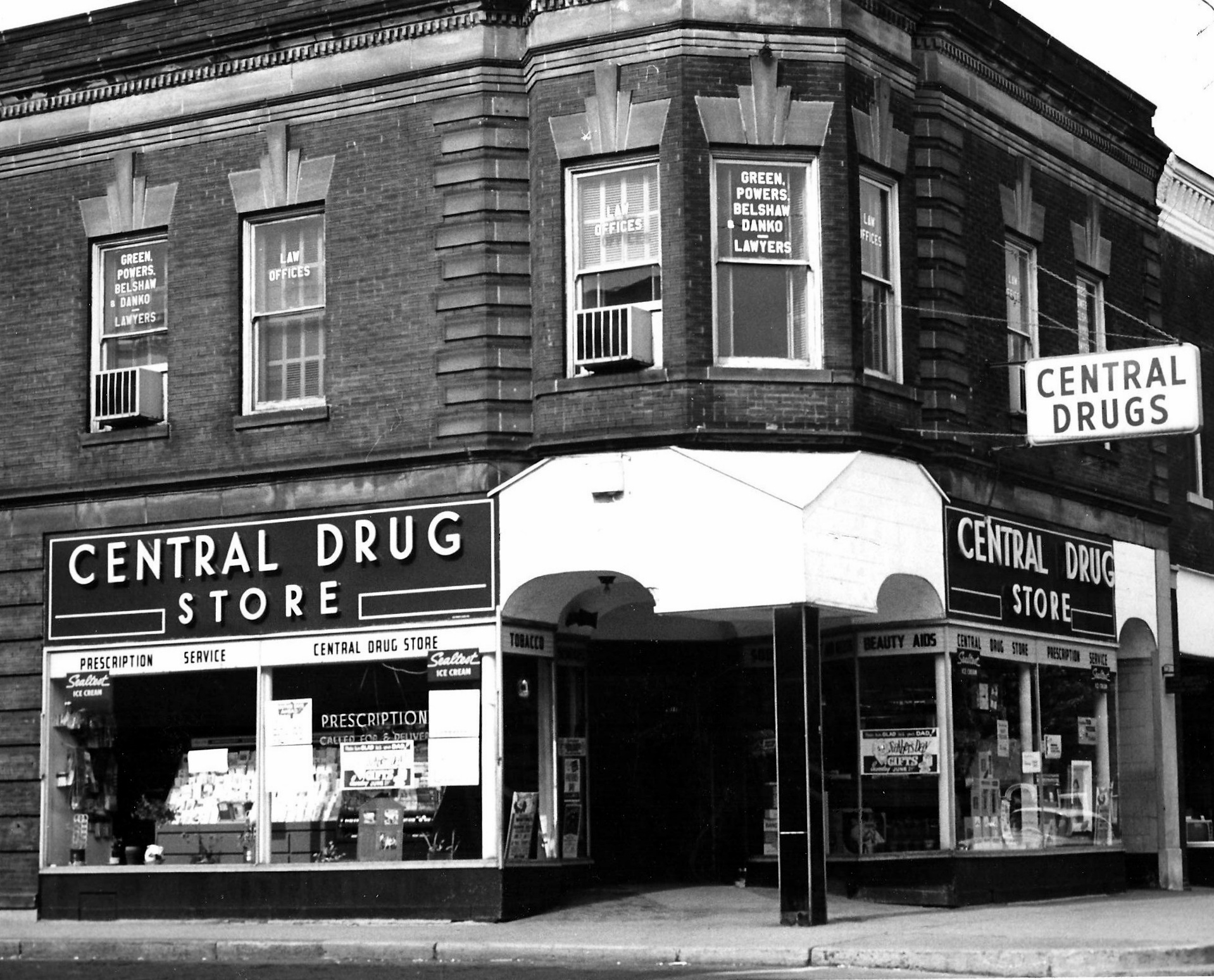Central Drug was located at 1452 119th Street. On the second floor of this building was the law office of Green, Powers, Belshaw and Danko. The second floor of numerous downtown building were often residential apartments or offices. It was common for lawyers, doctors, dentists, music teachers, and others who needed office space, to operate on the upper floors.