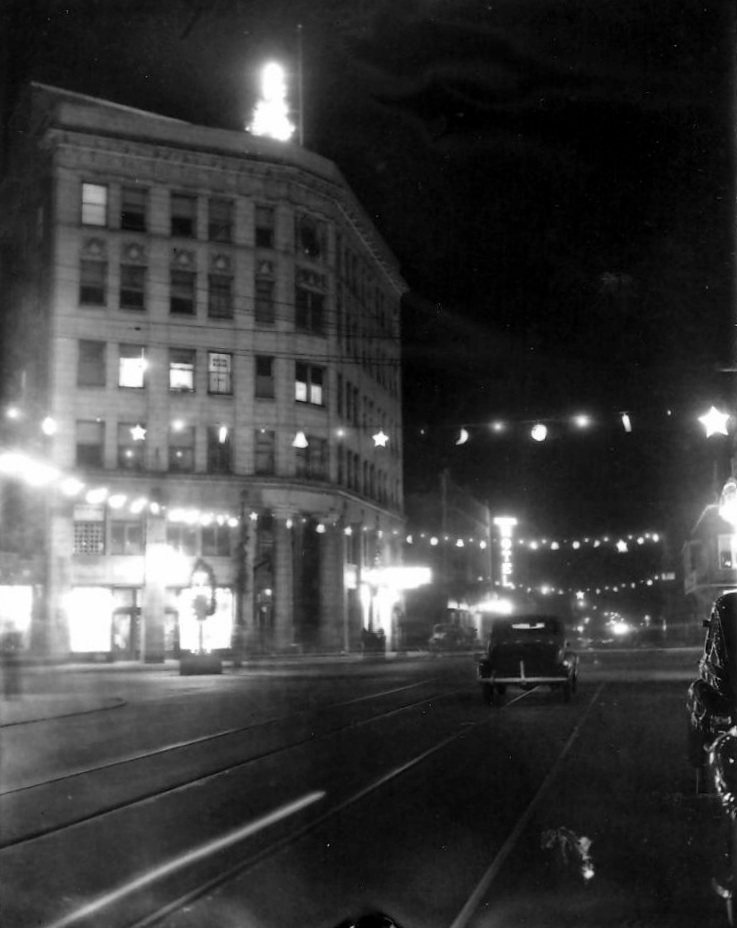A Christmas tree sat on top of the Central State Bank Building in this nighttime photo from around 1939. Notice the illuminated sign for the Illiana Hotel, located beyond the bank building, on 119th Street at the corner of Atchison Avenue.