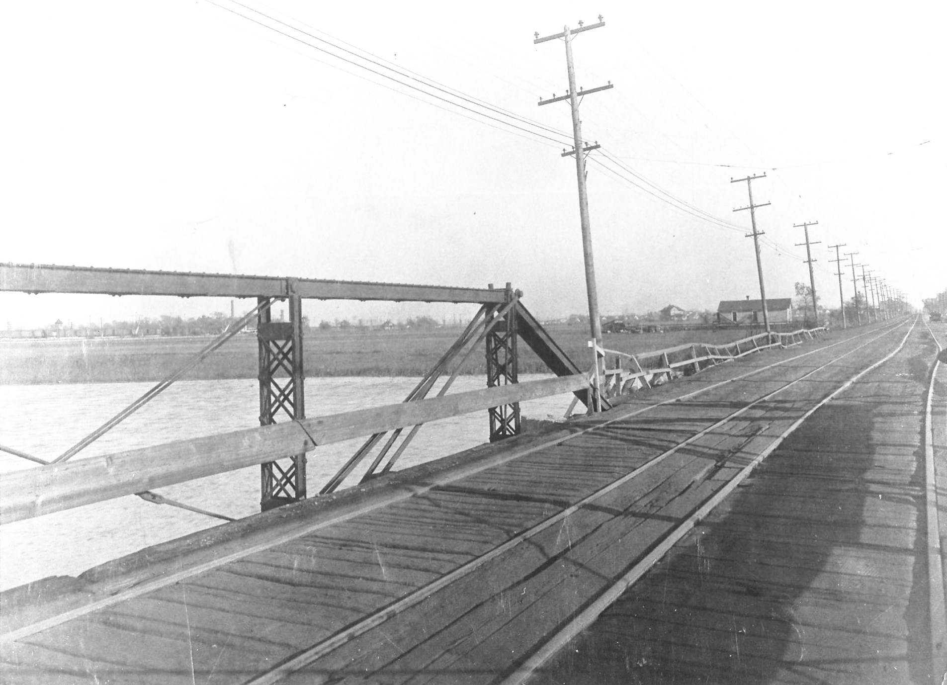 Growth changed the landscape of Whiting-Robertsdale. Wolf Lake, for instance, once flowed directly into Lake Michigan. Today, Indianapolis Boulevard crosses the arm of water at the northern end of Wolf Lake, taking thousands of motorists daily to and from Chicago. This photo shows one of the earliest bridges to cross that section of Wolf Lake. The photo was taken around 1900. The track in the middle of the bridge was for the street cars that connected Whiting-Robertsdale to Chicago, which was the primary way people from this area got to and from Chicago in the years before automobiles became common.