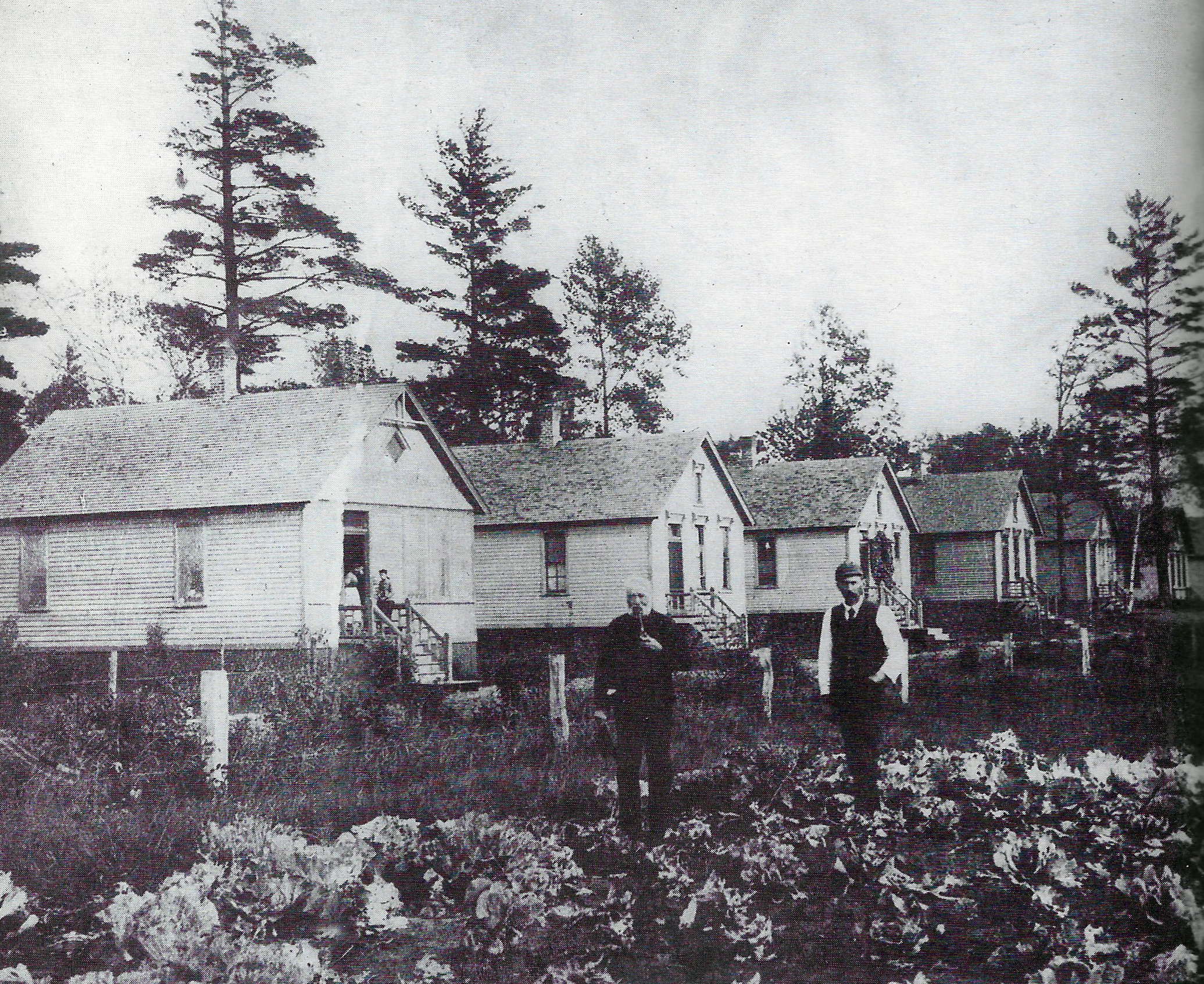 The Eggers family owned property along Berry Lake, which was located on Whiting's far east side on land that is now largely a part of the BP Refinery. The Eggers operated a business on Berry Lake which sold ice that they cut from the lake in the winter months. When Standard Oil arrived in 1889, they used some of the money they made from the sale of their land to the refinery, to build seventeen houses on their remaining land on Berry Lake. Henry Eggers Sr., who was born around 1817 in Germany, is in the center of this photo in front of the houses he had built. To his side is believed to be Henry Eggers Jr., in a photo from the 1890s.