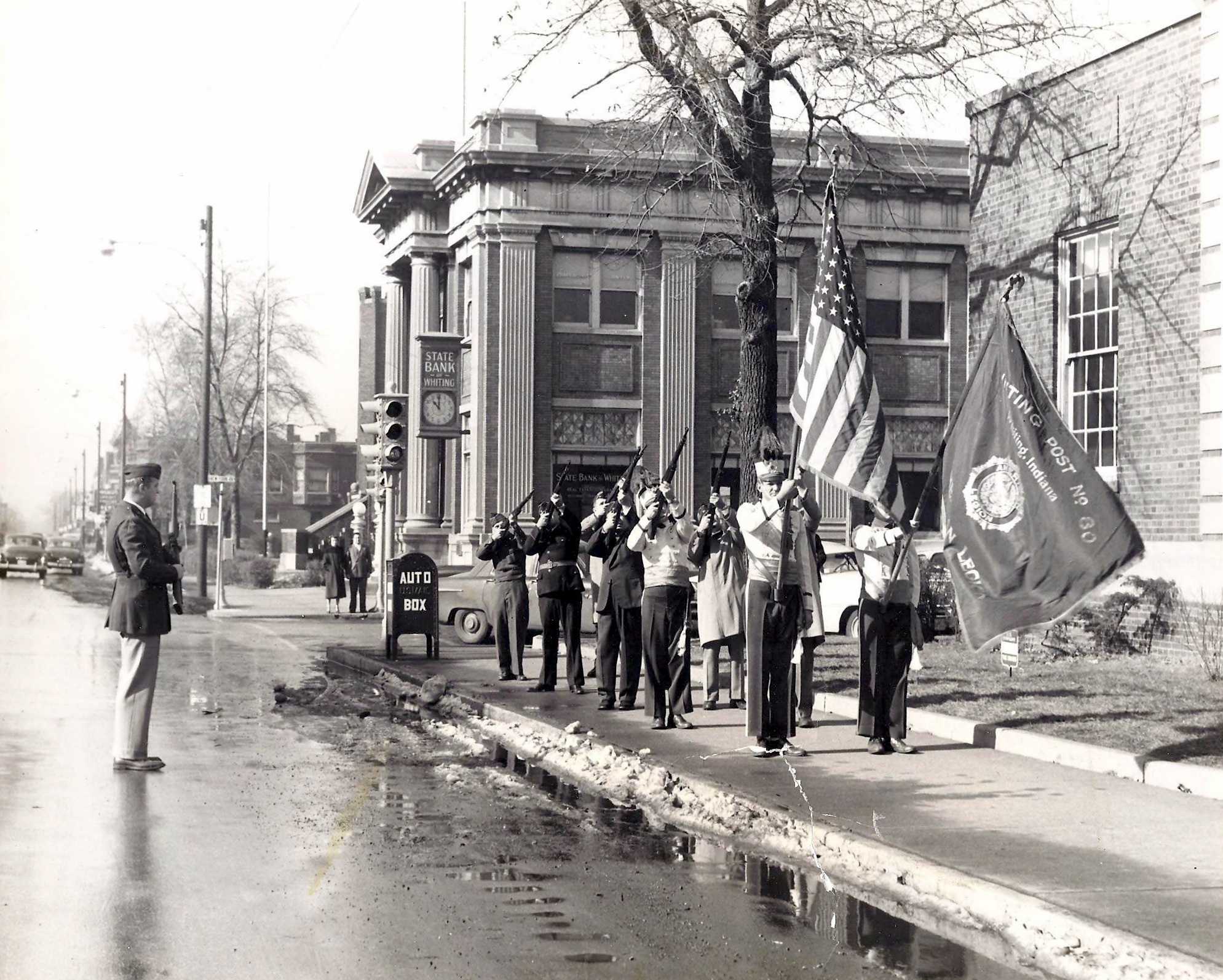 An early 1950s group of American Legion Post 80 members conduct a ceremony in front of the Whiting Post Office, with the State Bank of Whiting in the background. In its prime location at the corner of 119th and New York, the bank building has been the backdrop for numerous ceremonies, parades and other community events over the years.