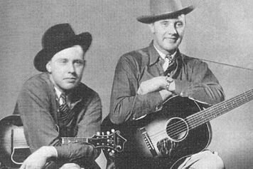 Bill Monroe lived in Northwest from 1929 to 1934. With his brother Charlie, pictured here in 1936 (Bill on left), he left his job at the Sinclair Oil Refinery in East Chicago to pursue an opportunity for a regular radio show. Photo courtesy of Wikipedia.