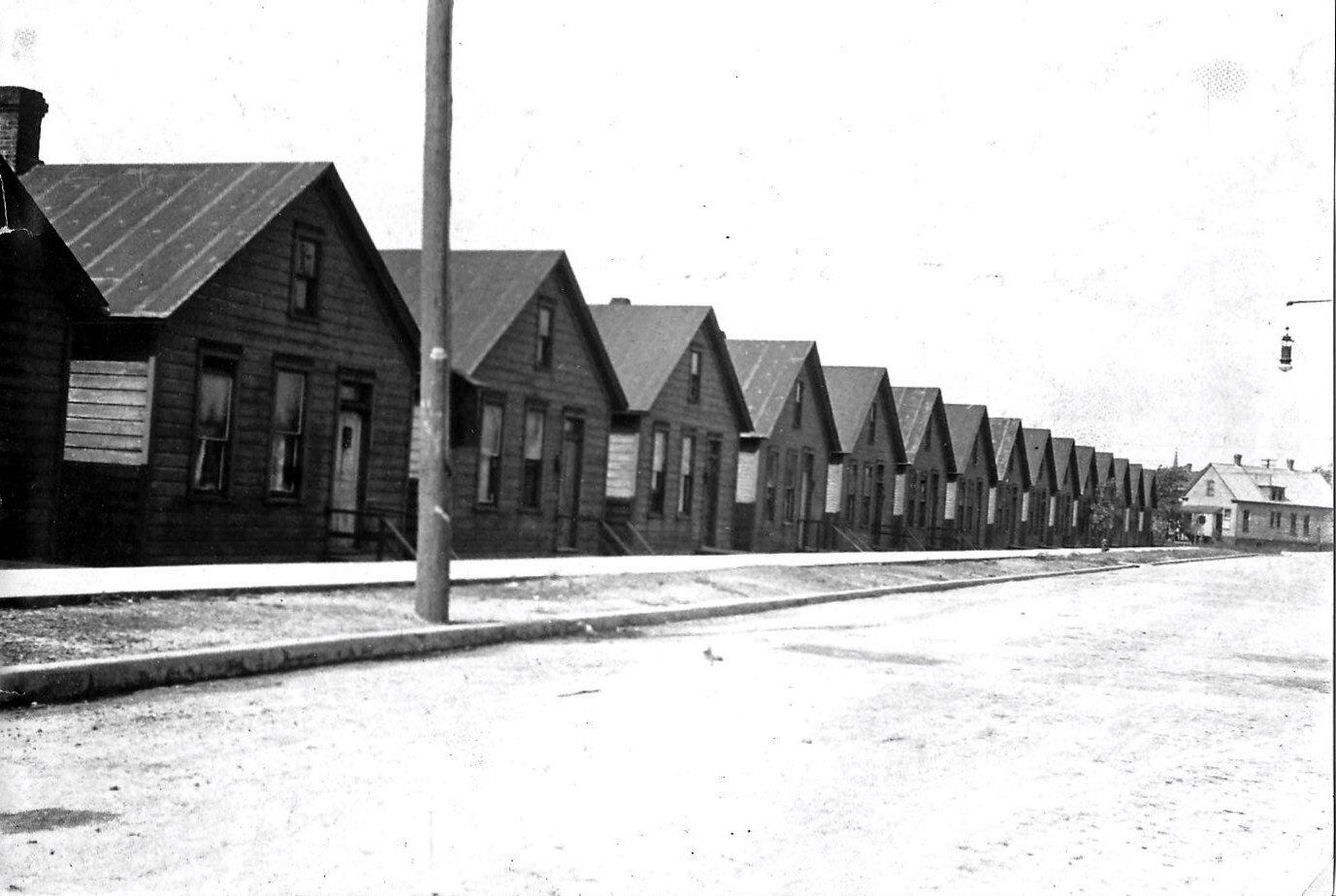 This is the site where the Whiting Community Center now stands. There were twenty small cottages here in 1923, on what was then called Short Street. All were torn down to make room for the Community Center.