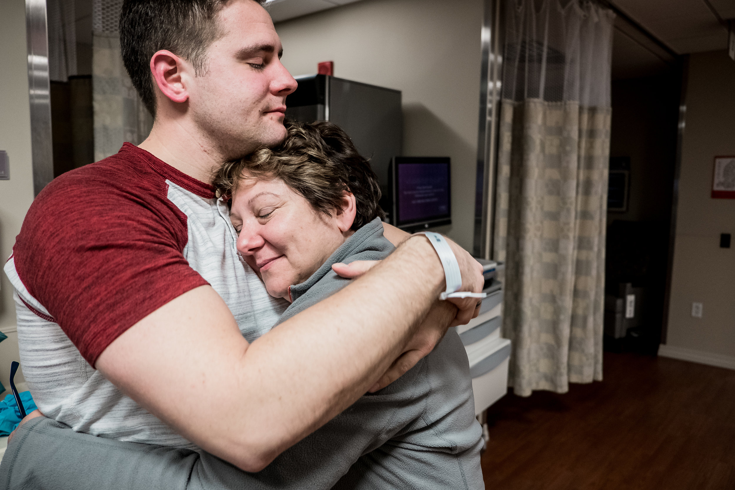 mother and son embracing after birth of baby
