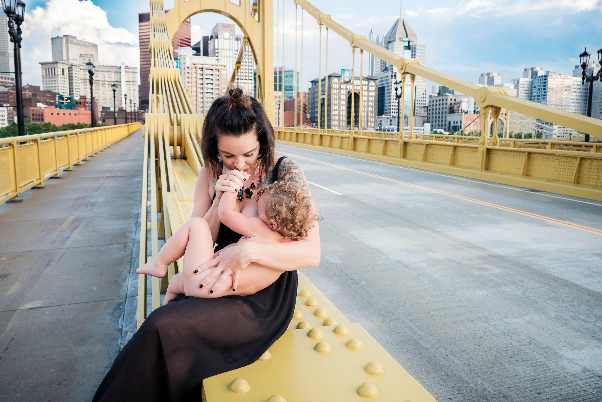 Pittsburgh Breastfeeding toddler on yellow bridge Northshore