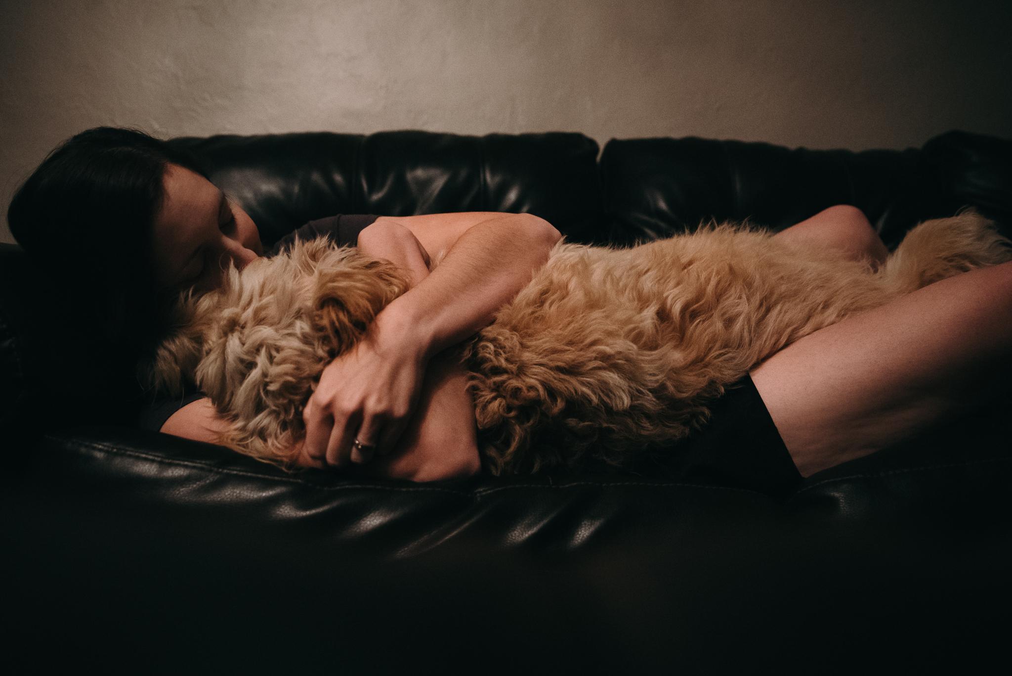 Girl with dog cuddling