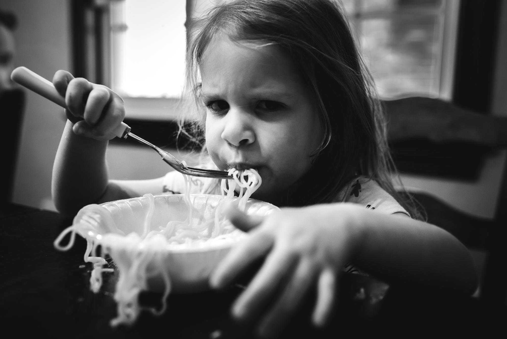 kid eating ramen noodles